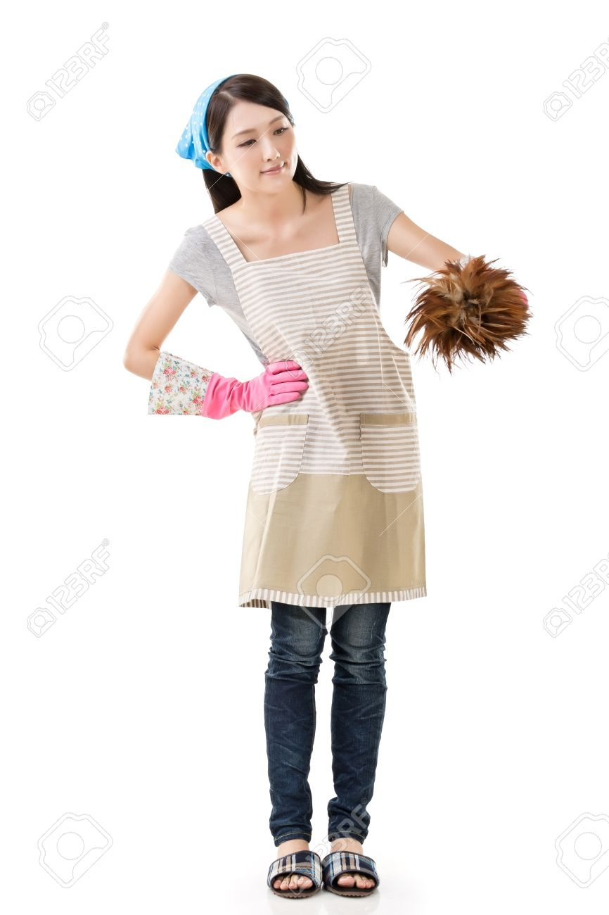 White gloves apron cleaning services - Woman Apron Gloves Portrait Of Asian Housewife Using Feather Duster Full Length Portrait On