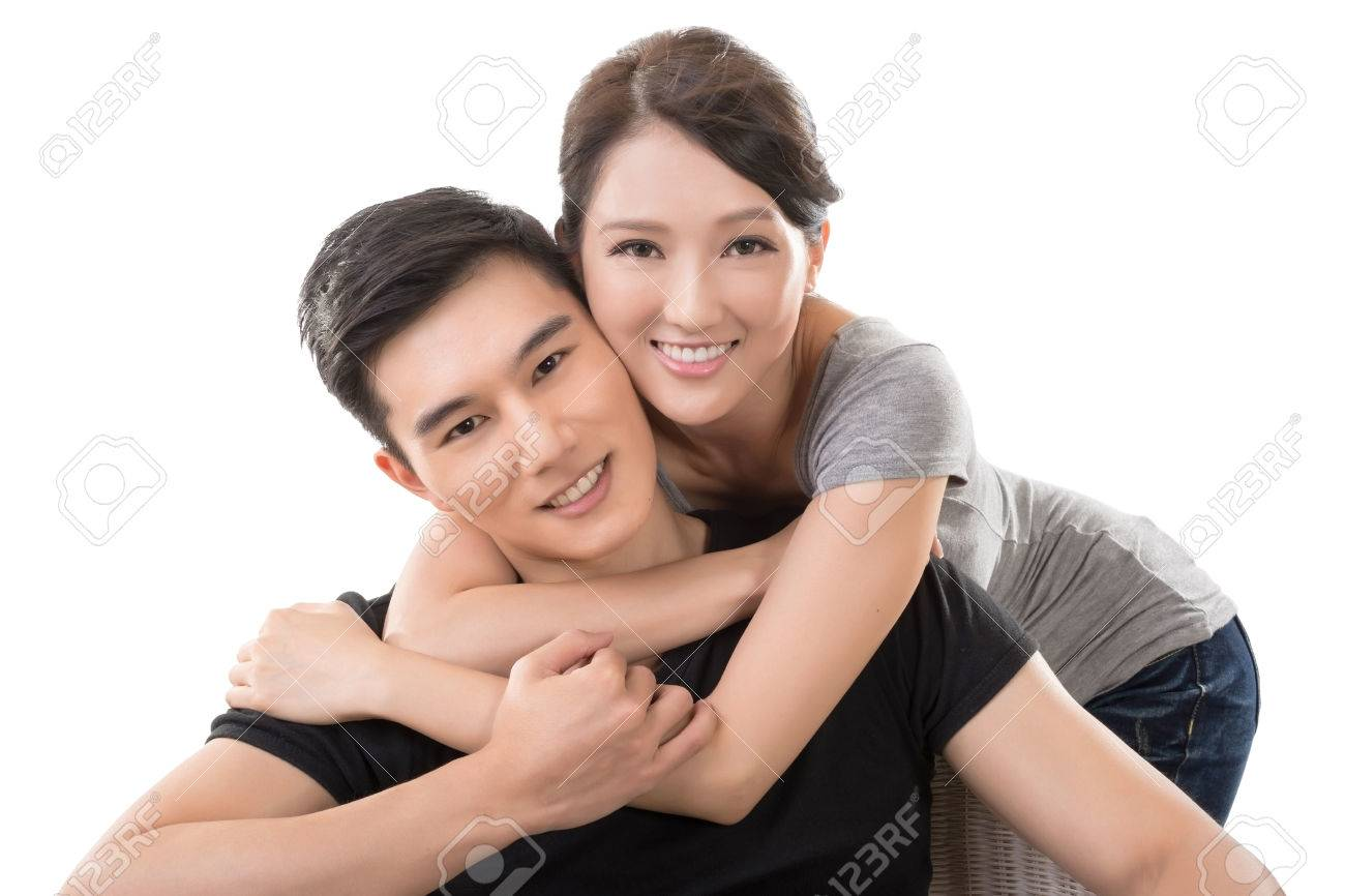 attractive young asian couple closeup portrait on white stock