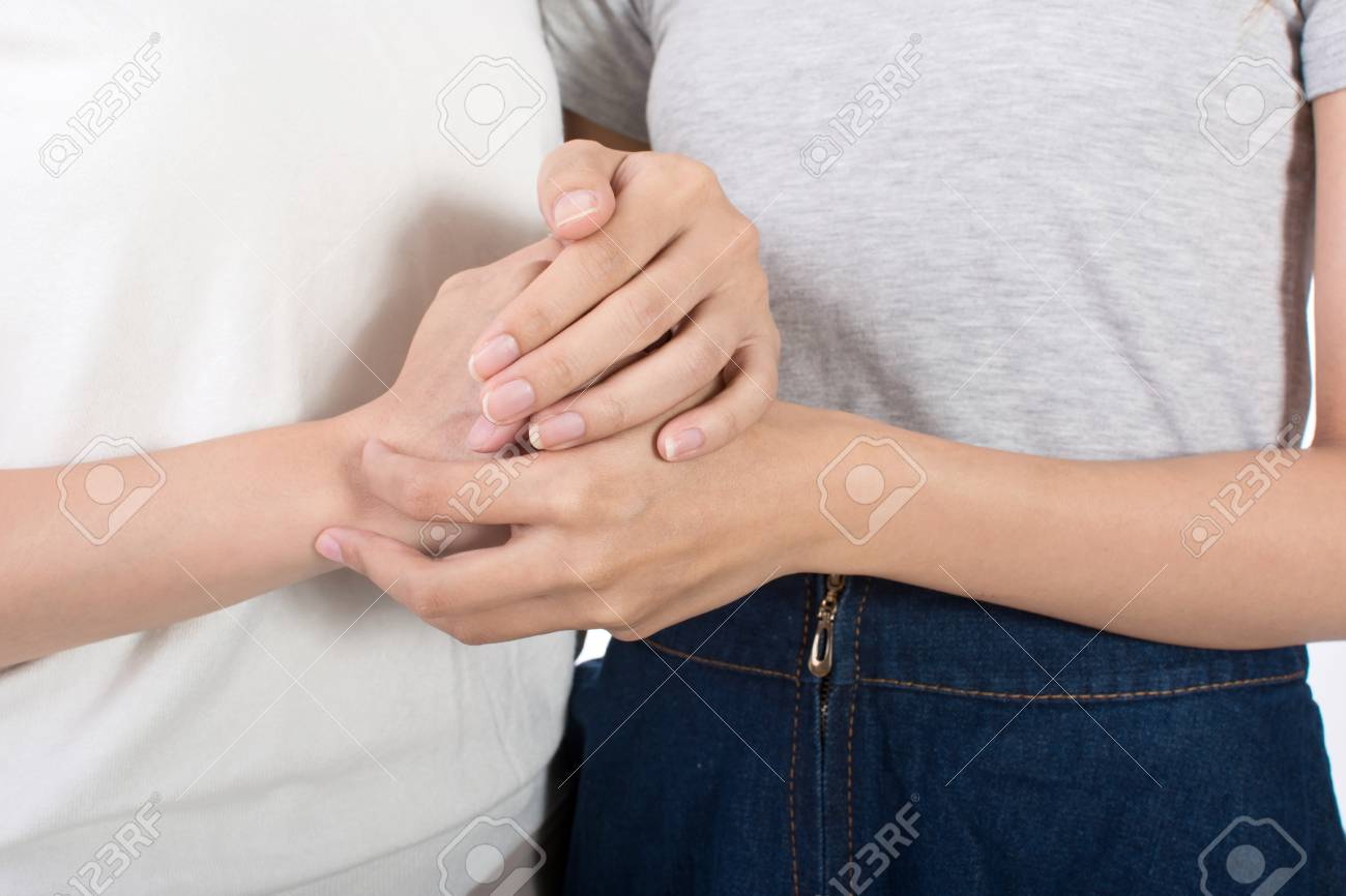 Troubled young girl comforted by her friend, closeup images focus on hand. - 50012628