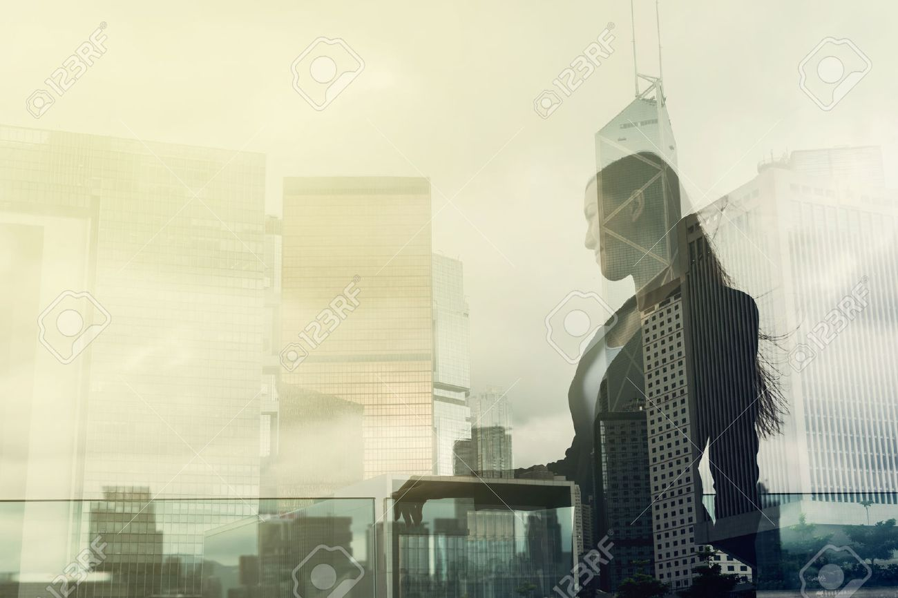 Silhouette of businesswoman stand and look far away in Hong Kong, Asia. Double exposure. Stock Photo - 49684043