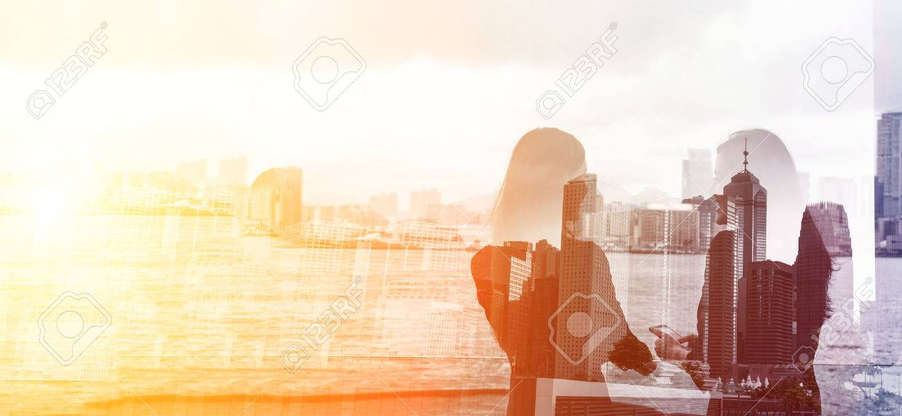 Silhouette of two businesswomen stand and look far away in Hong Kong, Asia. Double exposure. - 49684110