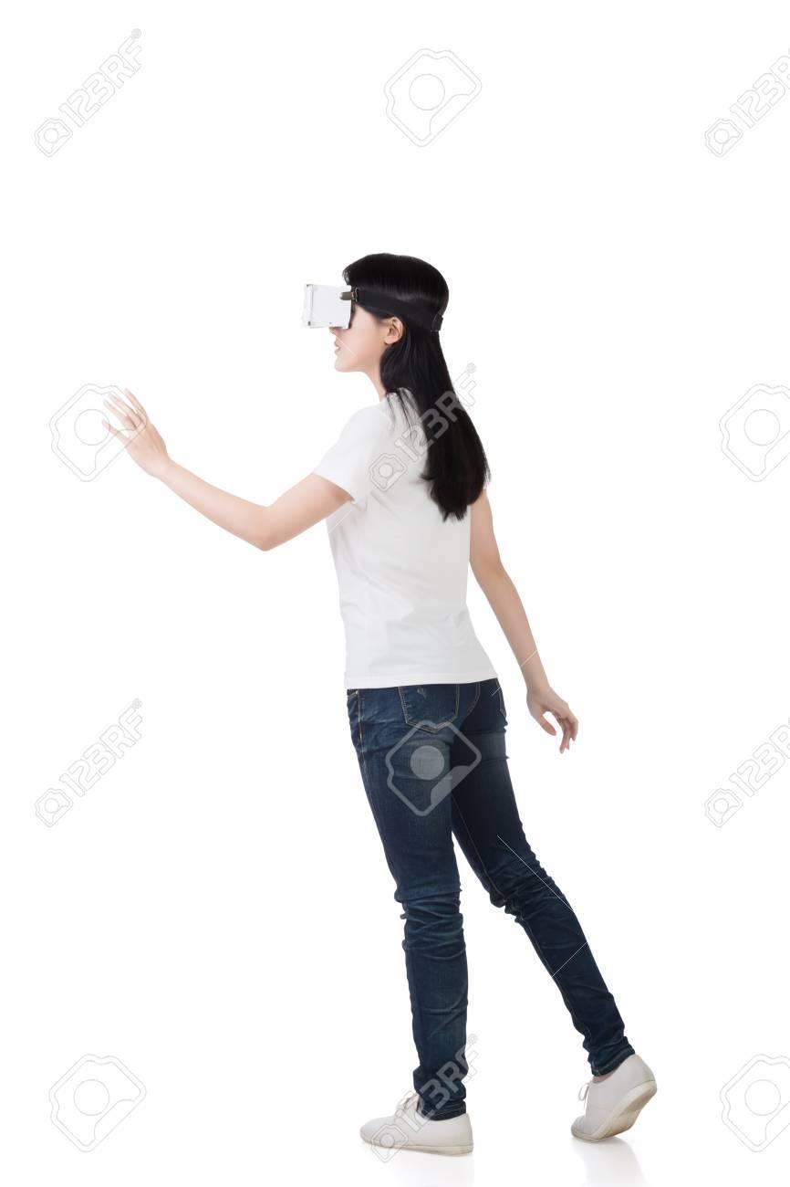 Woman using the virtual reality headset - 52914659