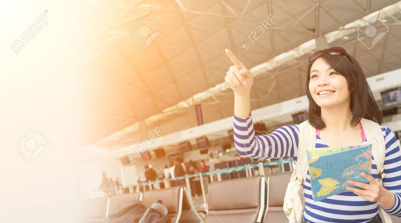 Asian young woman in the airport wait the aircraft - 56952294