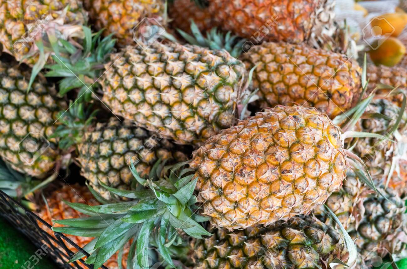 group of pineapple fruit at traditional marketplace in Taiwan - 127356140
