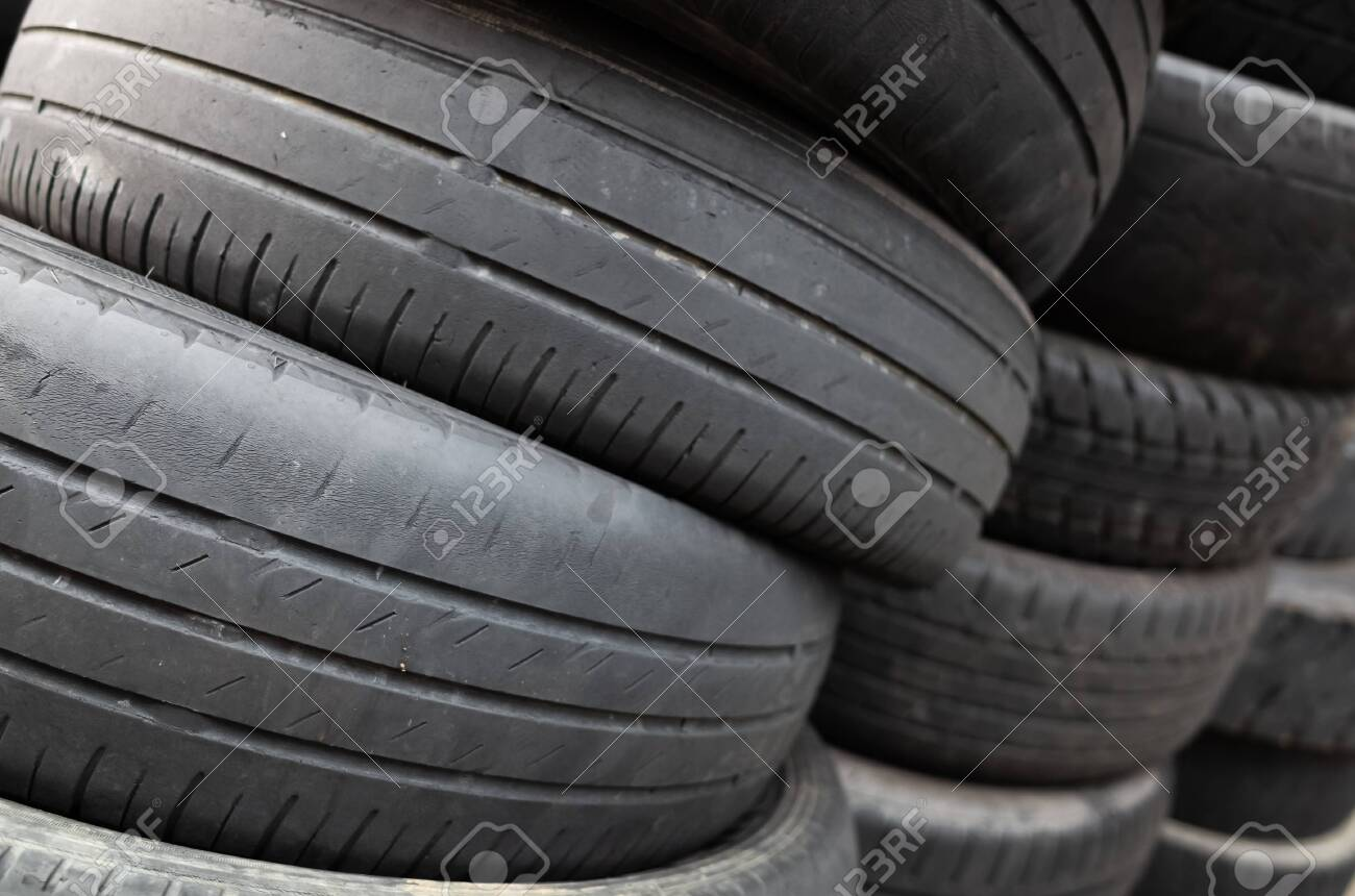 Used Car Tires >> Old Used Car Tires Stacked In Piles In The Daytime