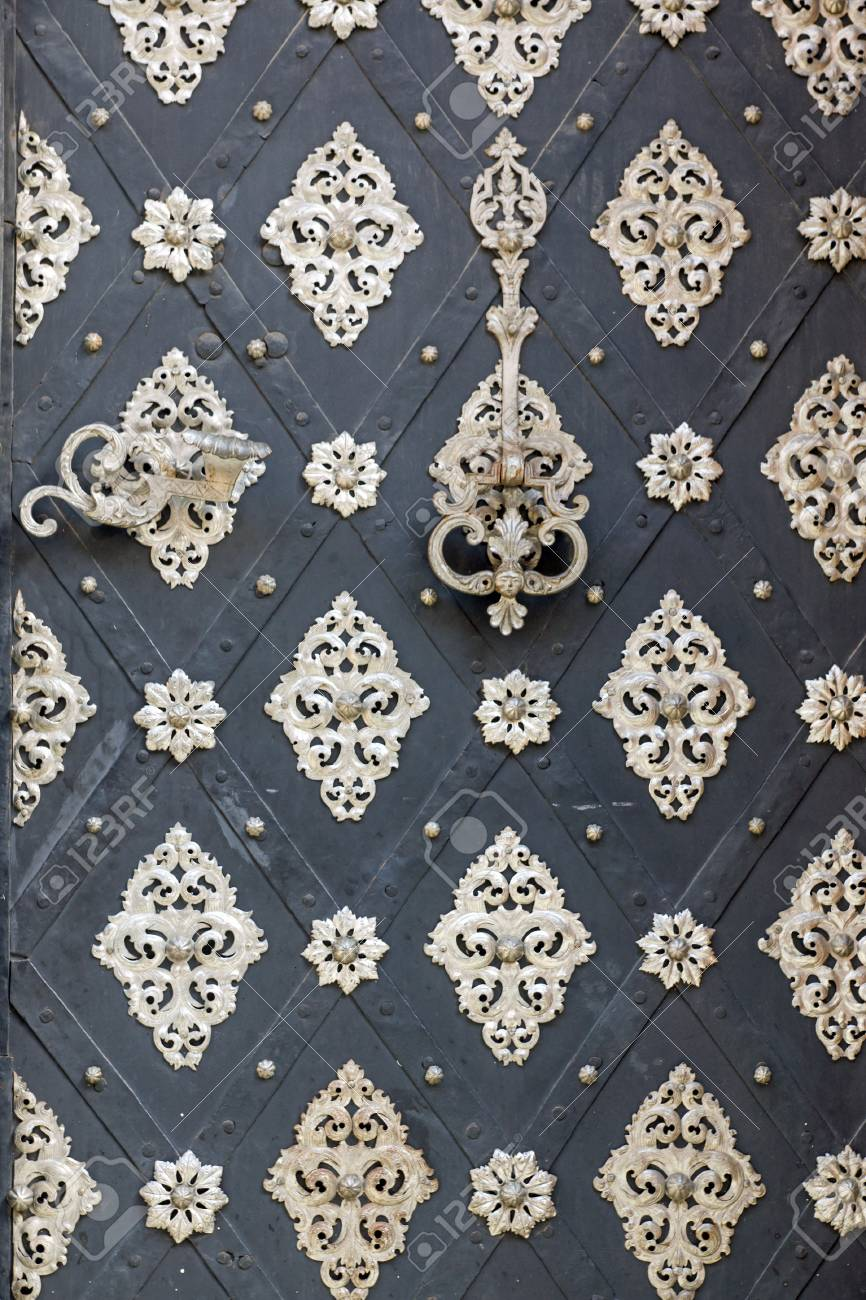 Silver ornated old door Stock Photo - 20886335