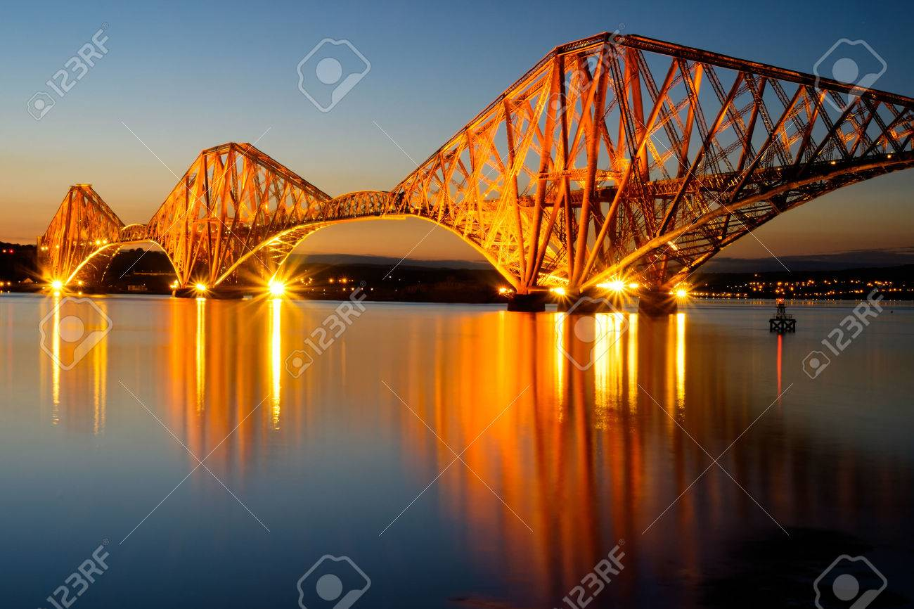 The Forth rail bridge illuminated at dawn - 30619876