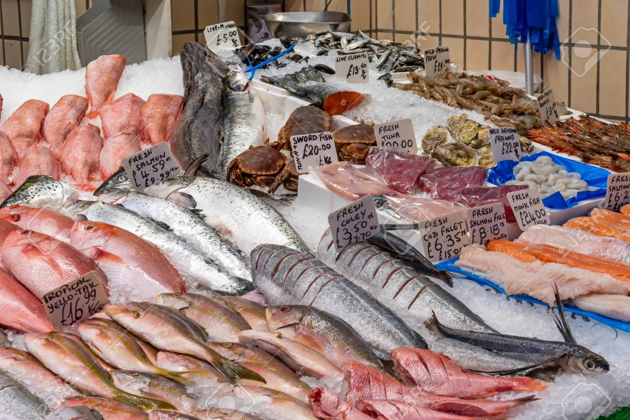 Market stall with fresh fish and seafood for sale lake in Brixton,