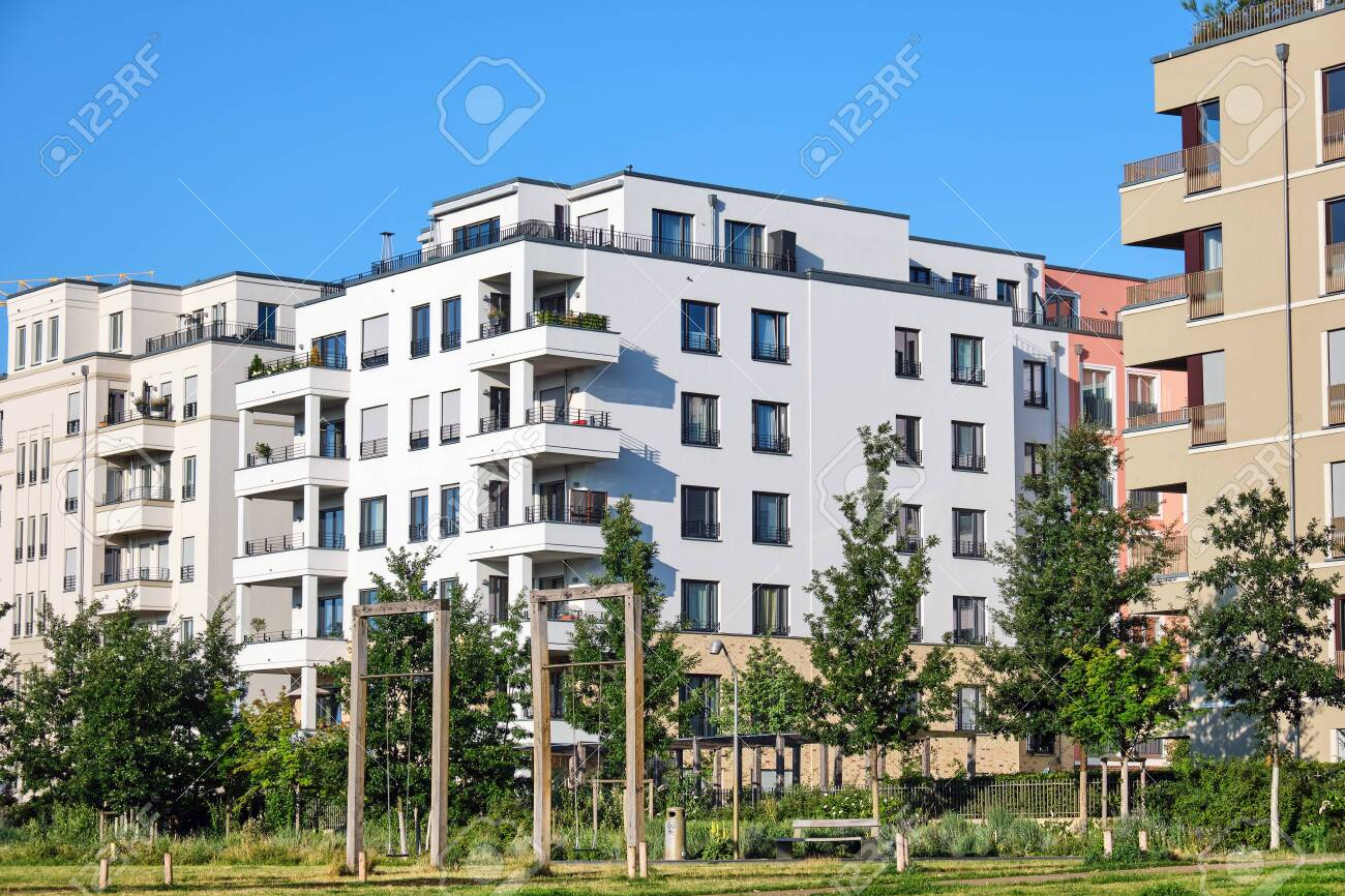 Modern apartment houses with a green park lake in Berlin, Germany - 130978715