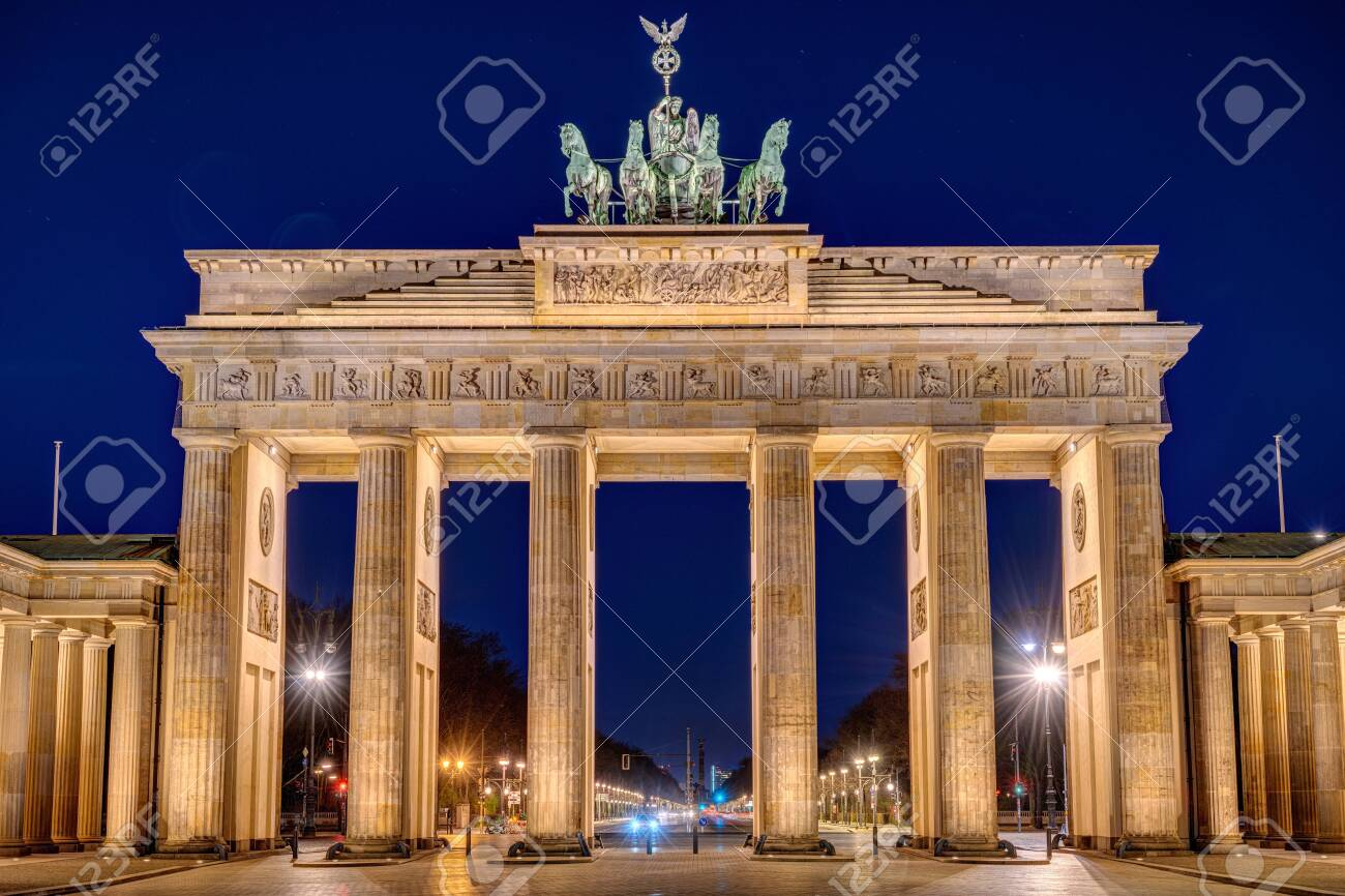 The illuminated Brandenburg Gate in Berlin at night with no people - 144571081