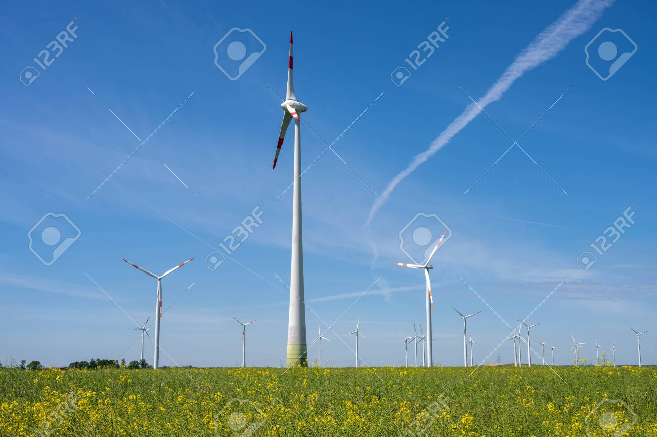 Wind energy generators in an agricultural field seen in Germany - 149137514