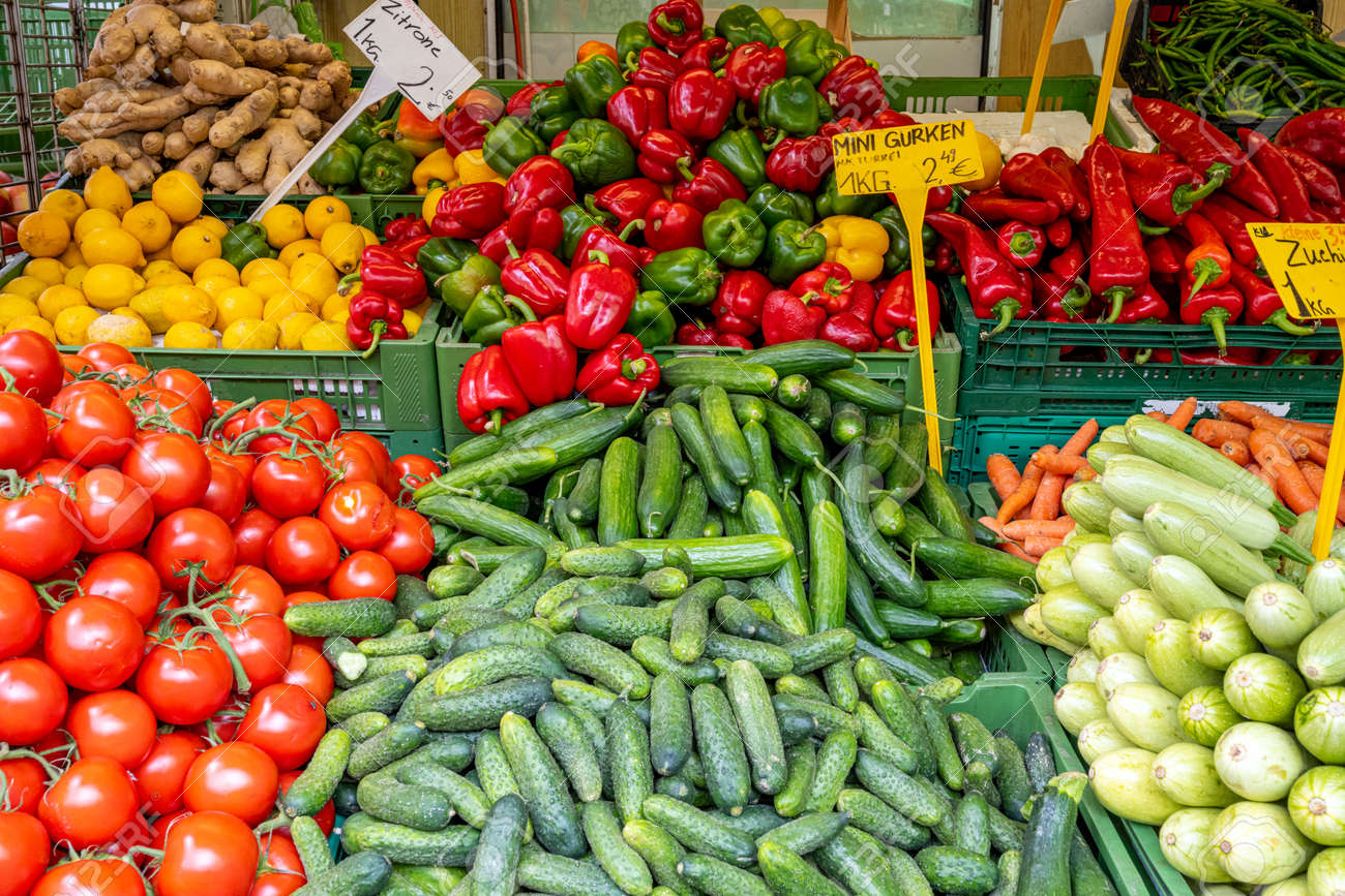 Colorful market stall with fresh vegetables for sale - 159243828