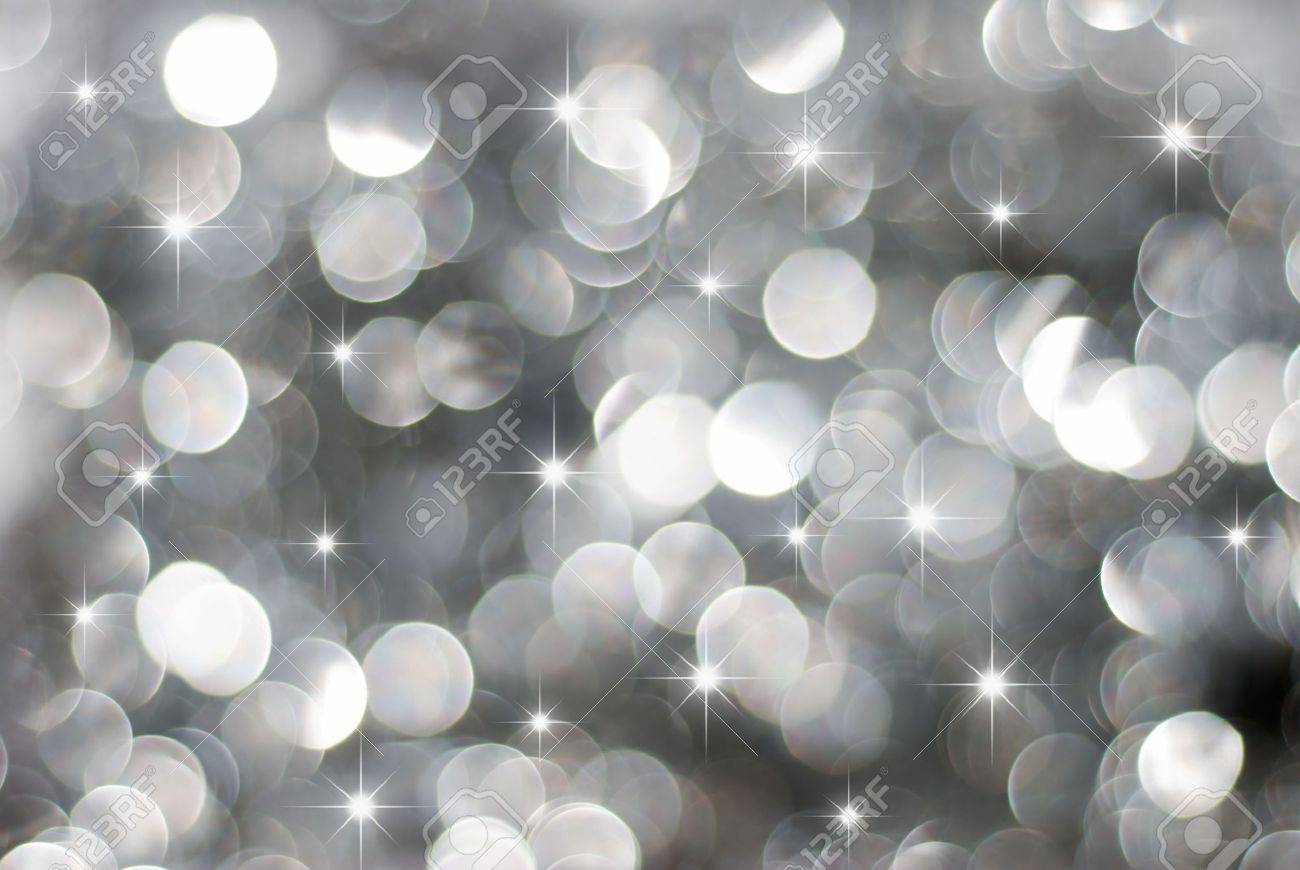 glowing silver christmas lights background with little stars stock photo 5530785 - Silver Christmas Lights