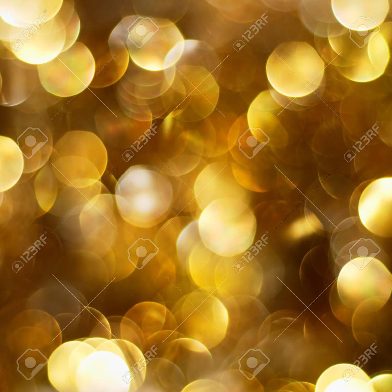 Dark golden defocused Christmas lights background Stock Photo - 8140489
