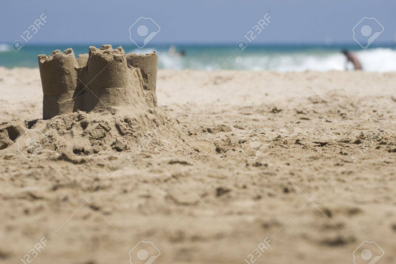 Small sand castle on the beach with ocean in the background. Stock Photo - 3379347