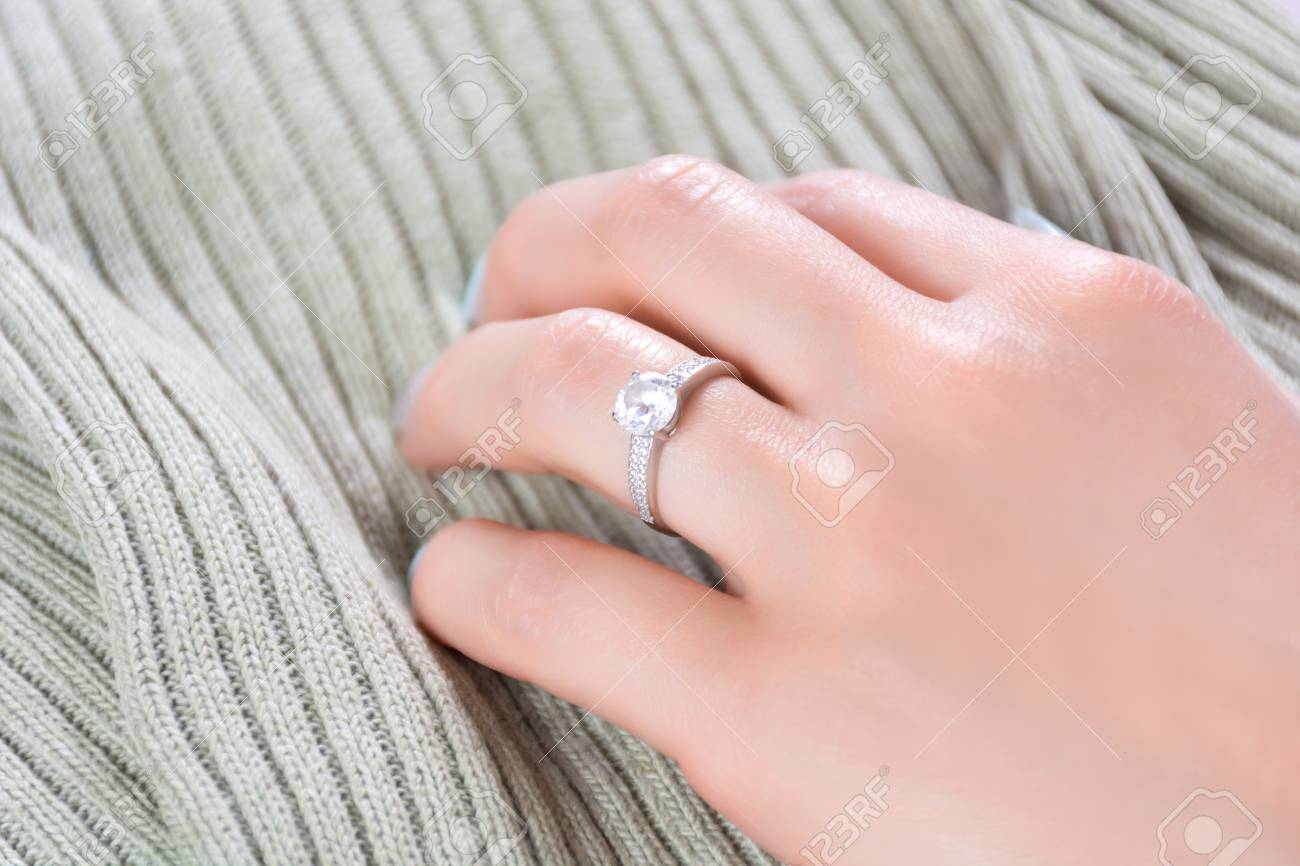 Which Hand Wedding Ring Female.Female Hands With Diamond Engagement Wedding Ring On Fabric Texture