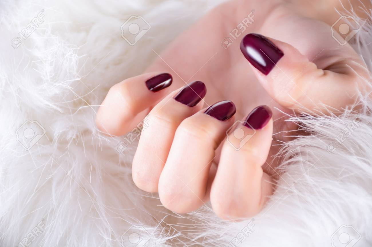 Girl Hand With Red Wine Color Nails Gel Polish On Finger Nails