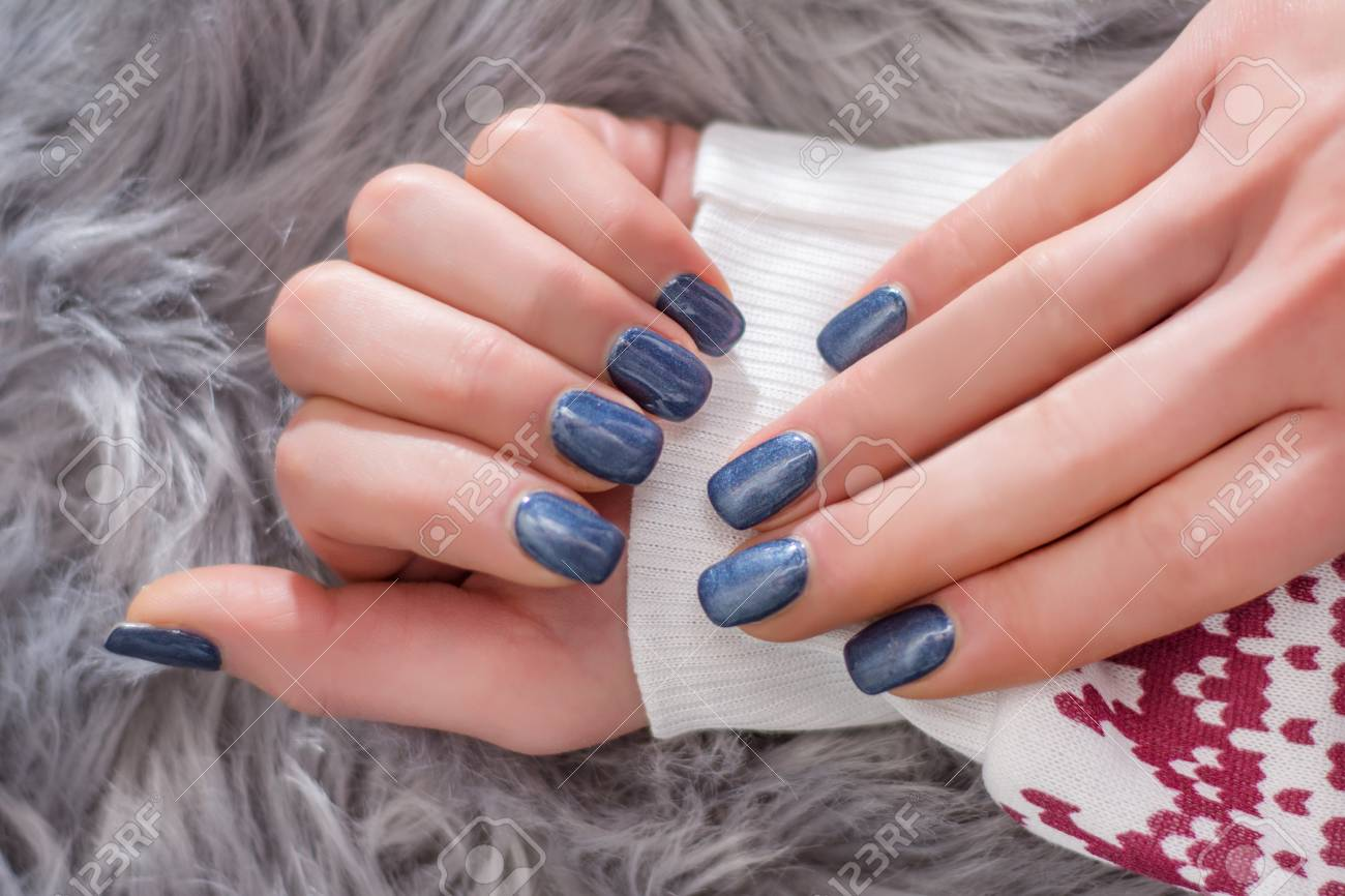 Girl Hands With Navy Blue Nail Polish Color On Winter Sweater ...