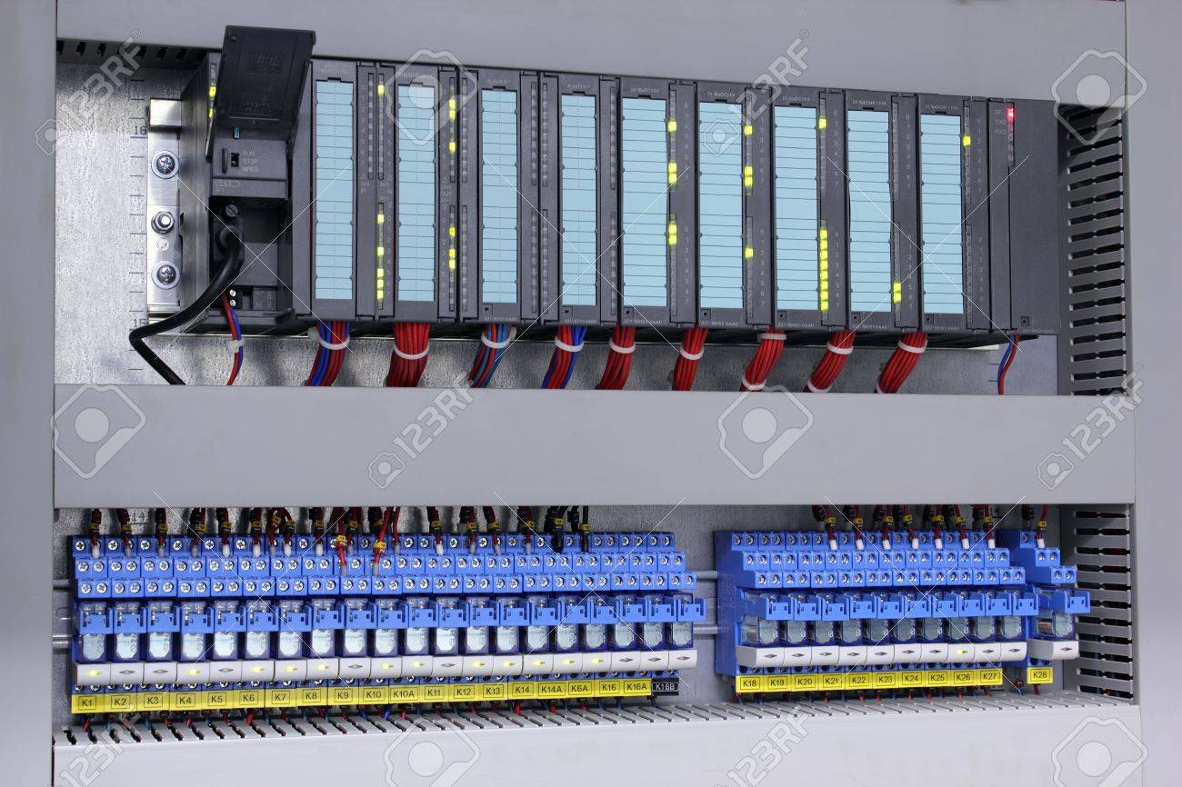 Programmable logic controller and relays in industry Stock Photo - 9252142
