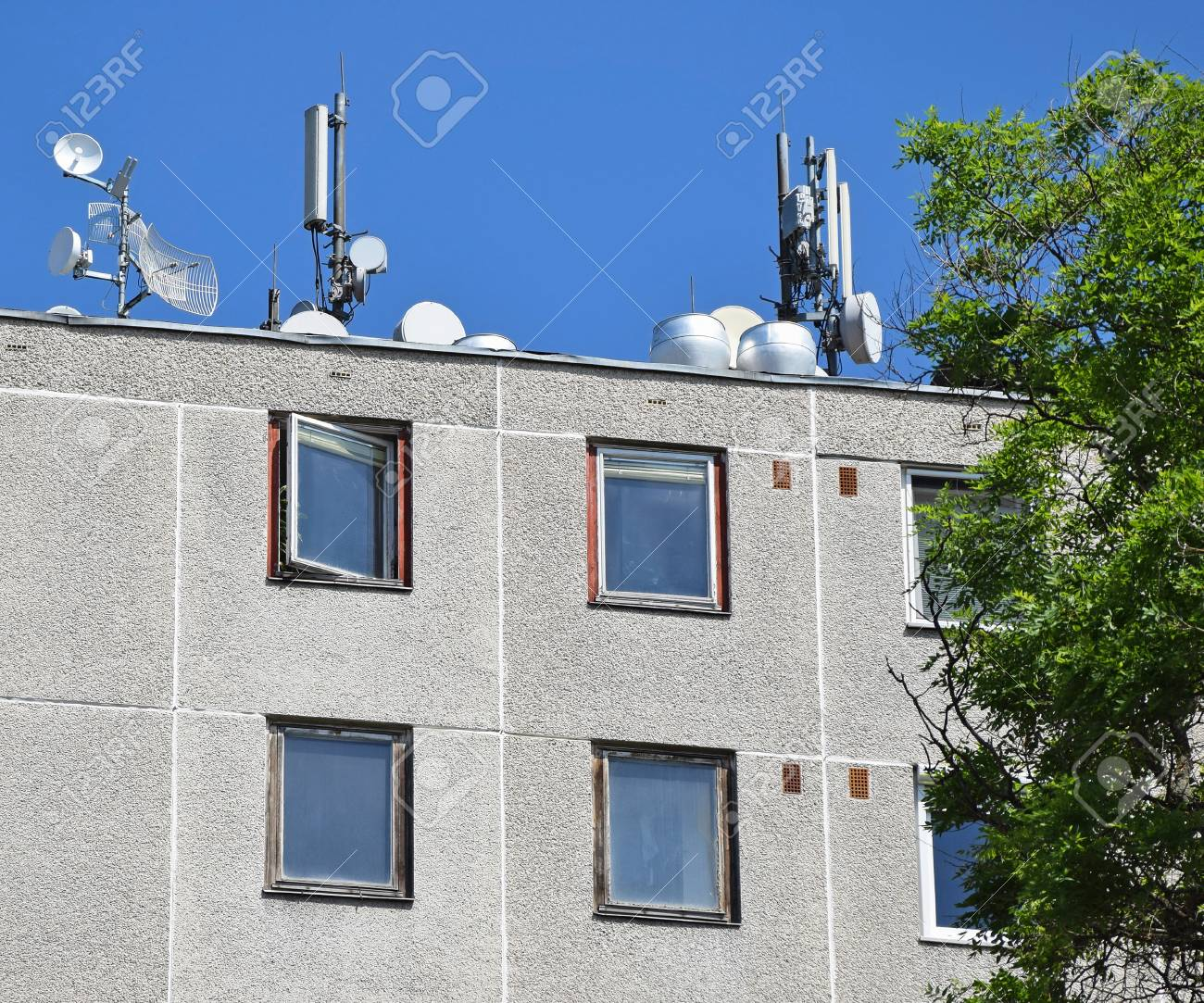 Antennas On The Top Of An Apartment Building Stock Photo ...