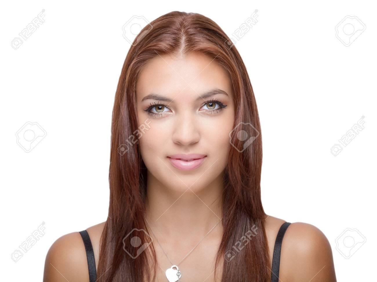 Female With Auburn Hair Hazel Eyes Looks Ahead Smiling Stock Photo