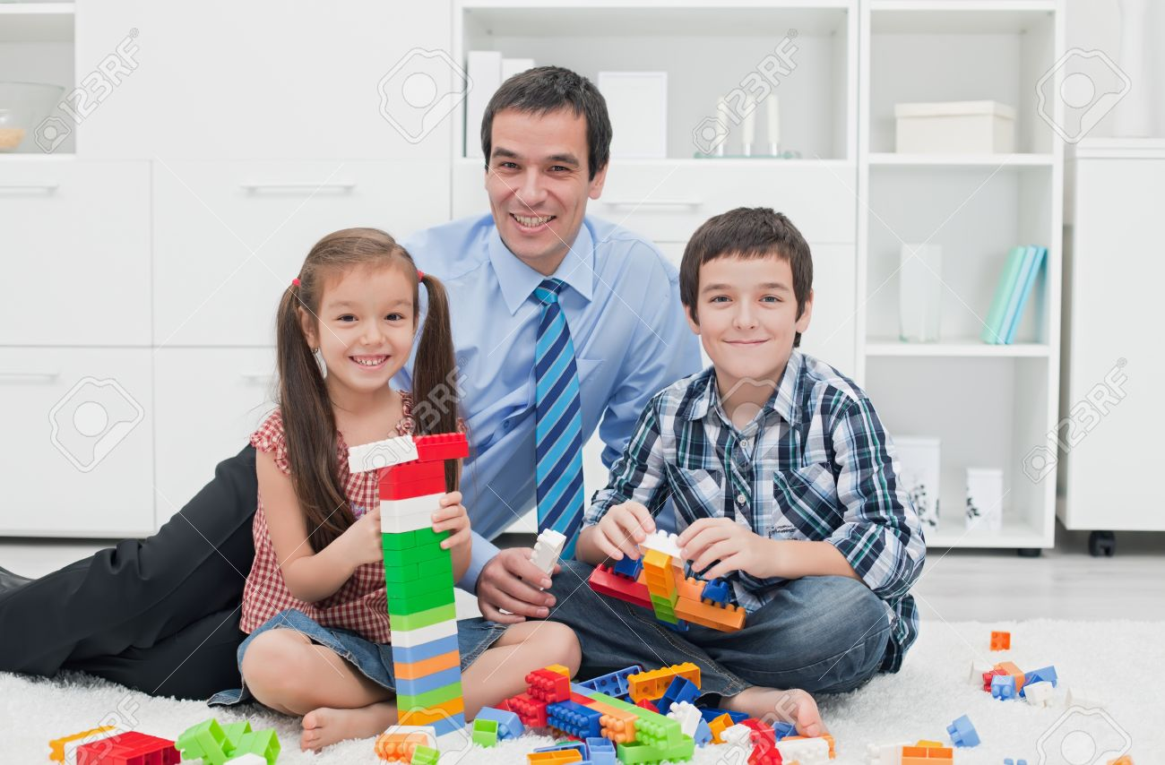 Businessman playing with his children after the working time Stock Photo - 16971104