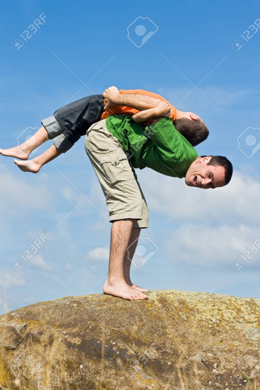 Boy balancing on his father's back Stock Photo - 17108194