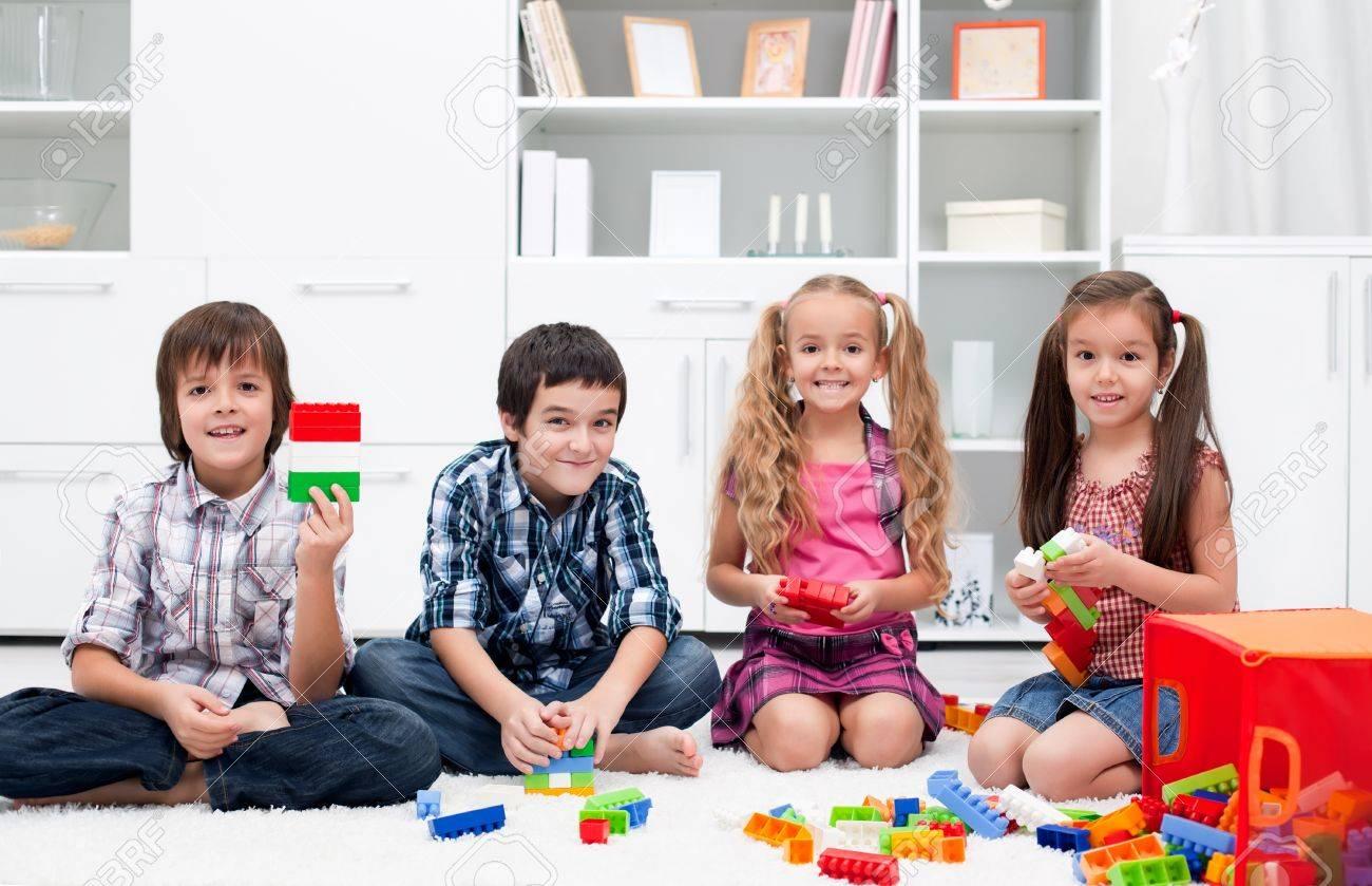 Happy children playing with blocks Stock Photo - 17190681