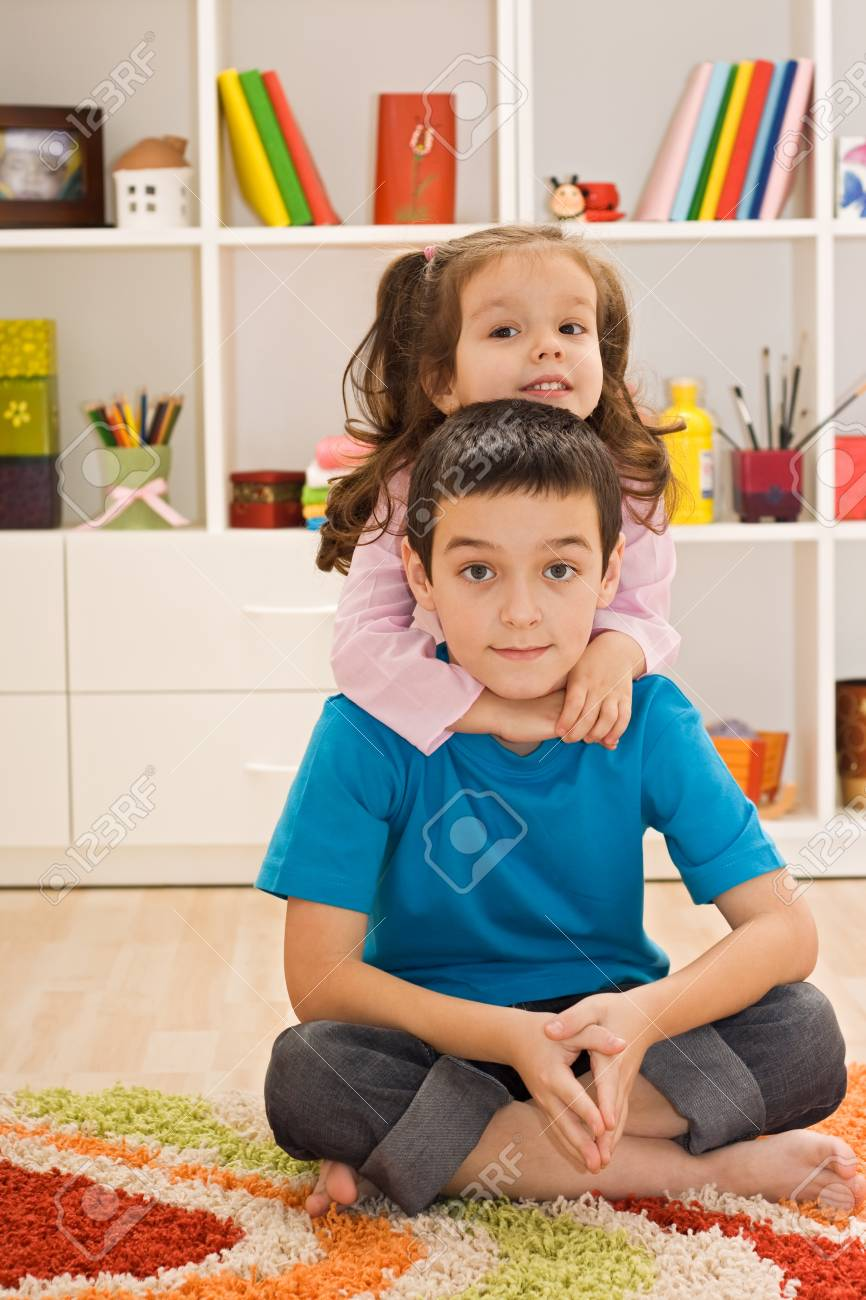 Little girl embracing her brother Stock Photo - 17415966