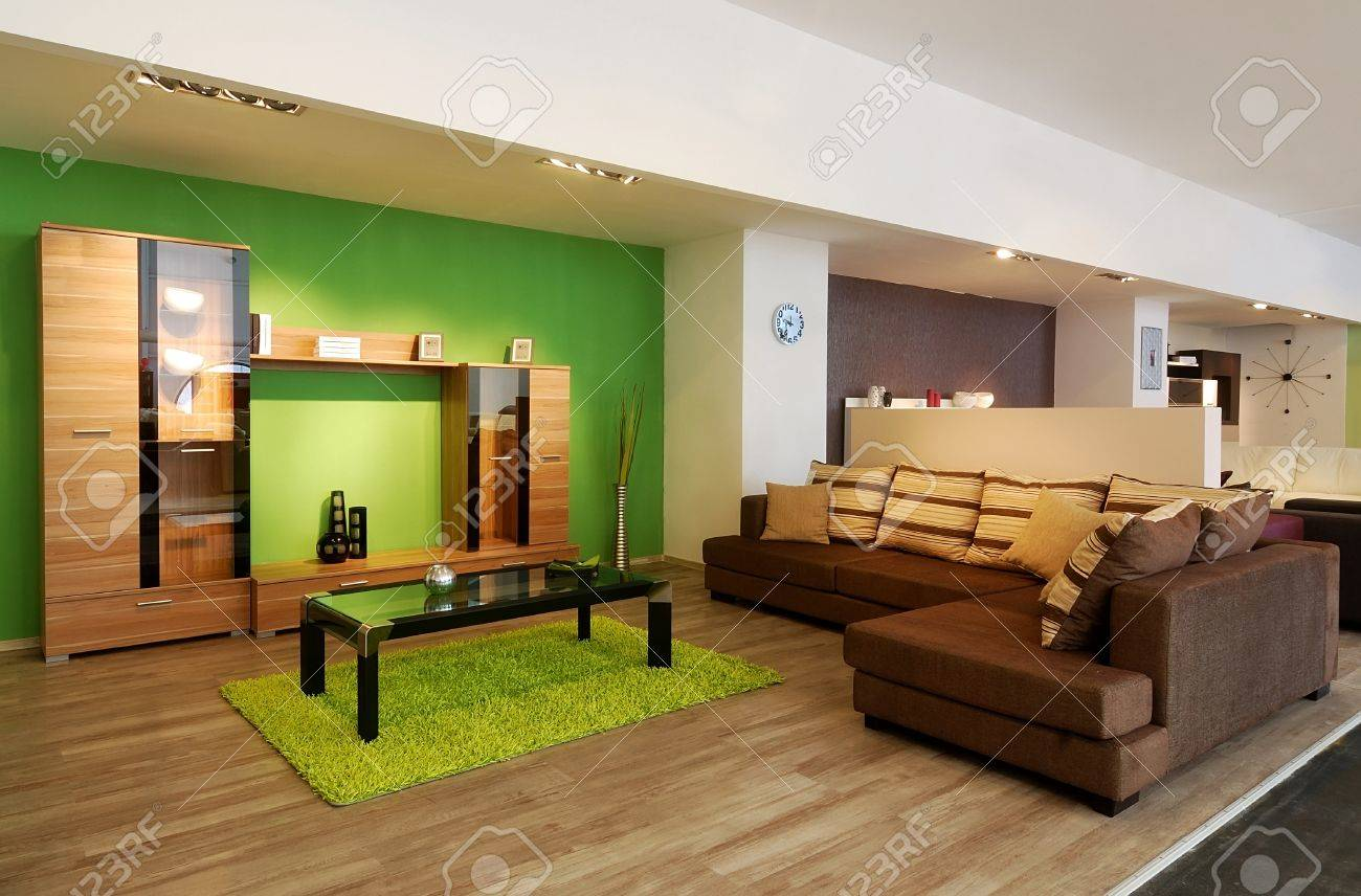 An Image Of A Modern Living Room With Brown Sofa And Green Walls