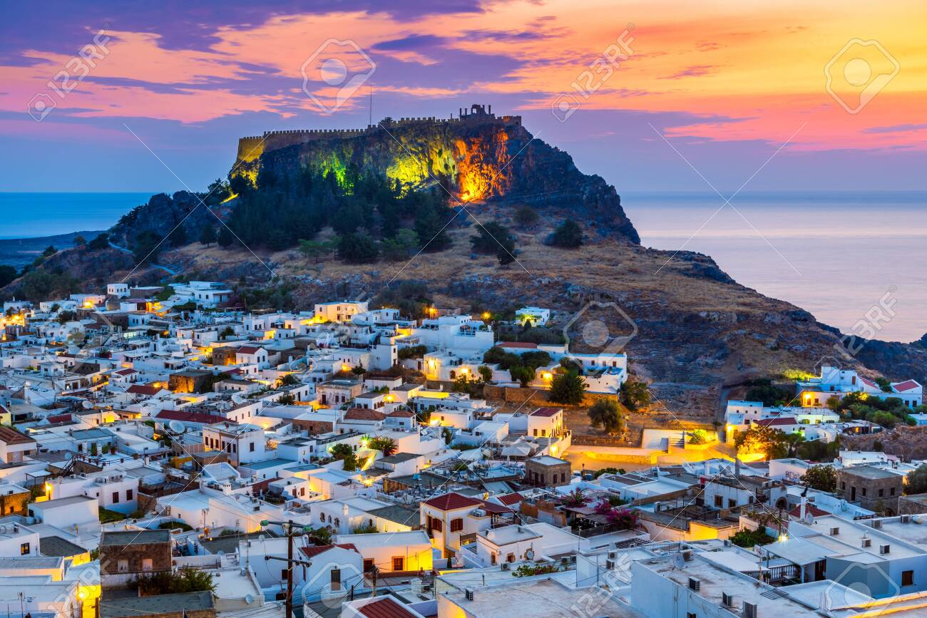 Rhodes, Greece. Lindos small whitewashed village and the Acropolis, scenery of Rhodos Island at Aegean Sea. - 131734525