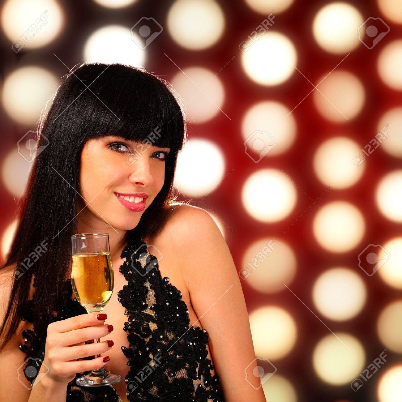 Portrait of a young woman holding a champagne glass Stock Photo - 11468407
