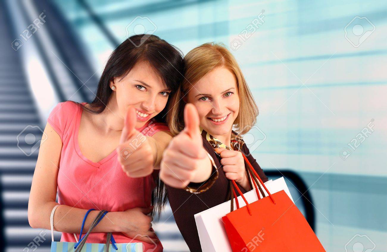 Two women at the mall, thumbs up Stock Photo - 12515327