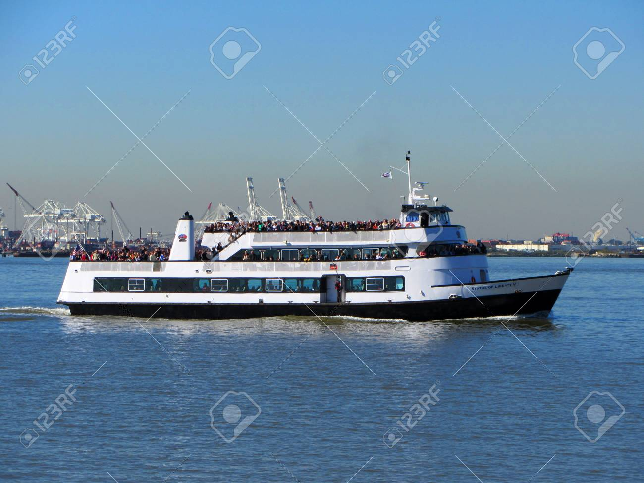 tourists aboard the statue of liberty ferry stock photo, picture and