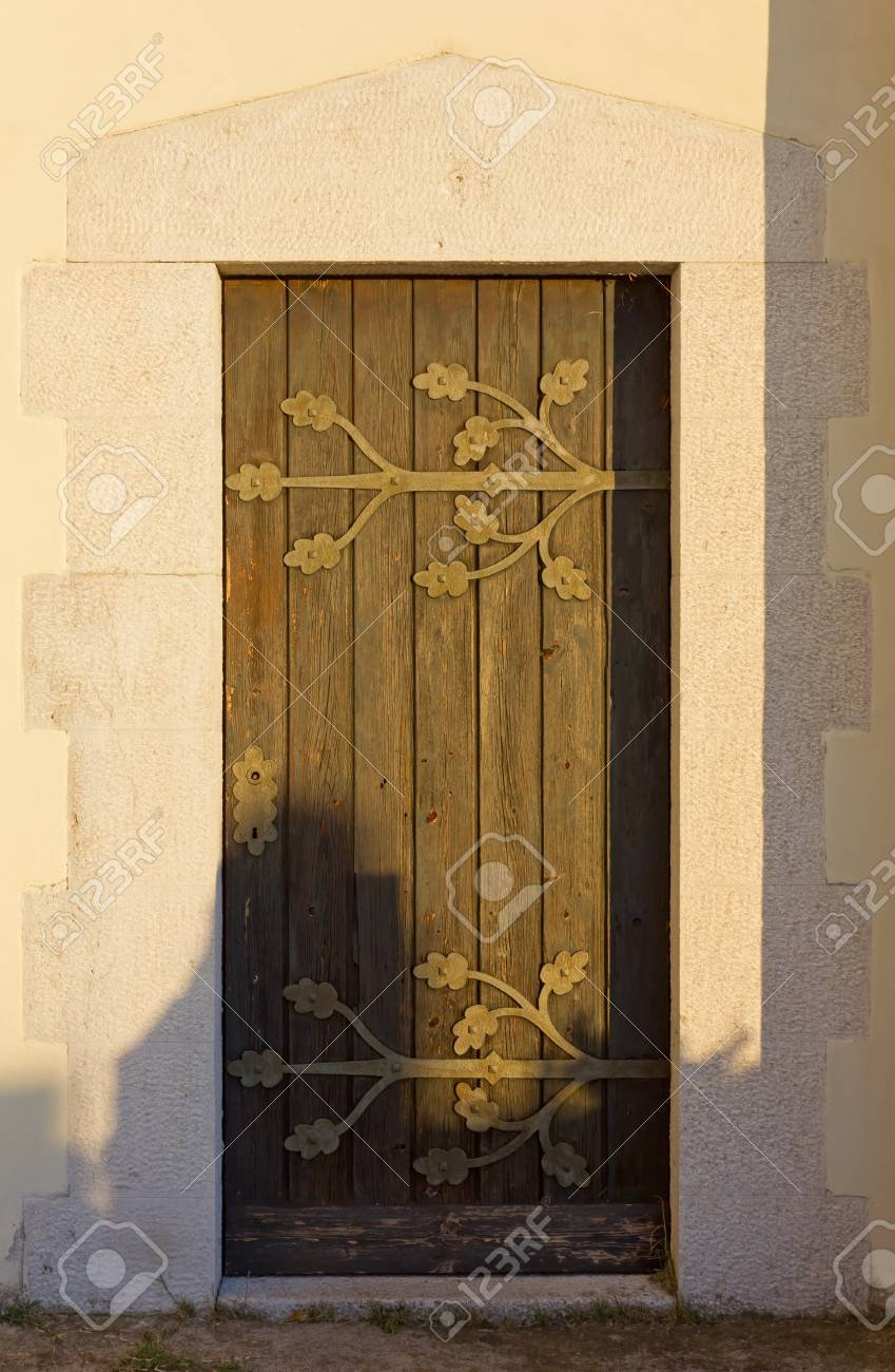 Old Wooden Country Church Door At Sunset Stock Photo