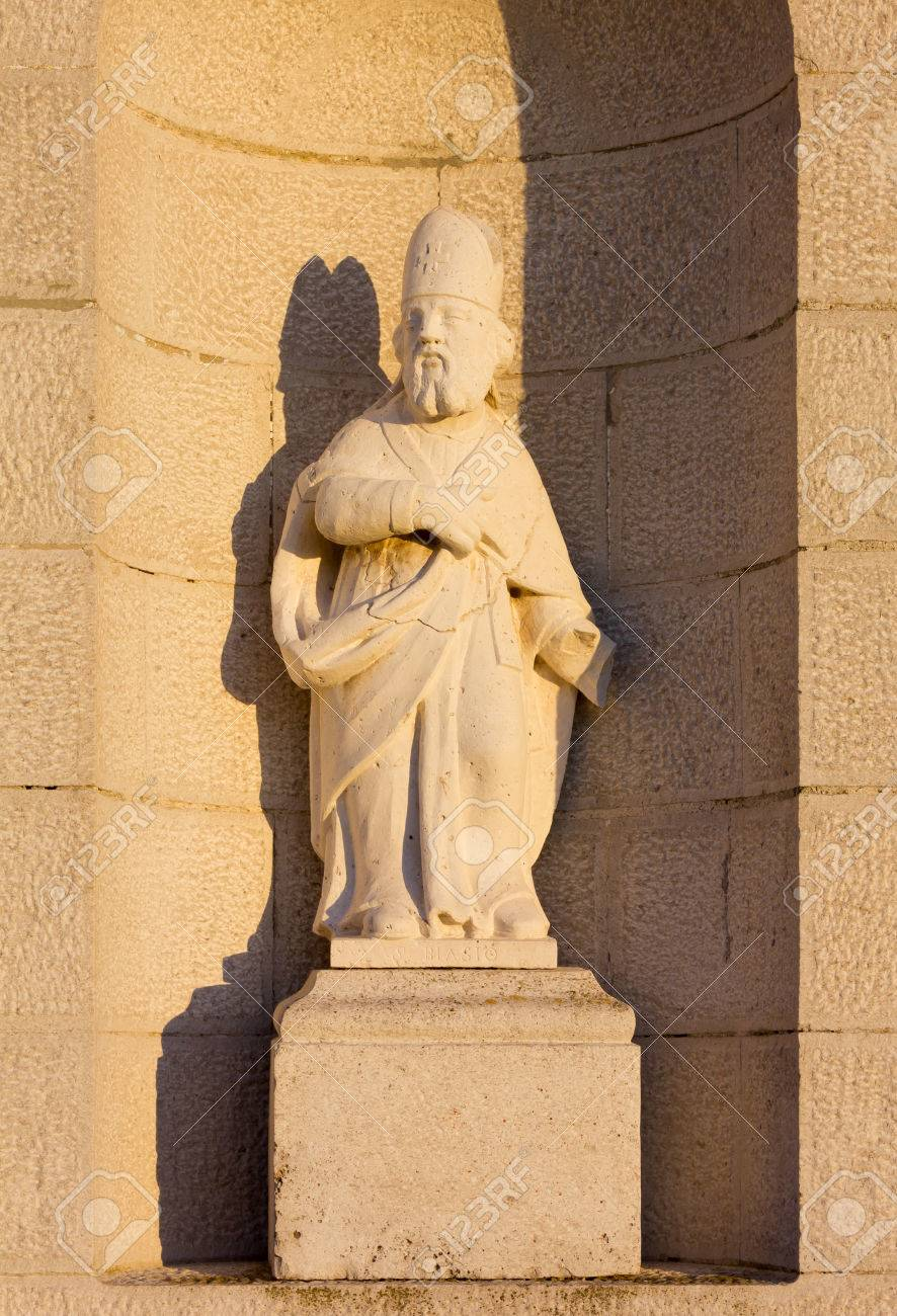 Saint Blaise Statue On The Facade Of A Country Church At Sunset Stock Photo