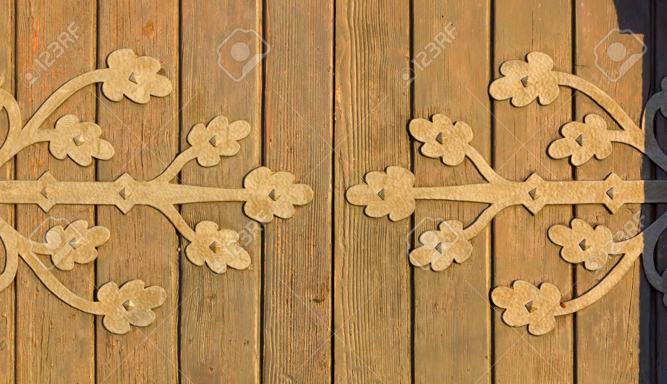 Detail Of An Old Wooden Country Church Door At Sunset Stock Photo