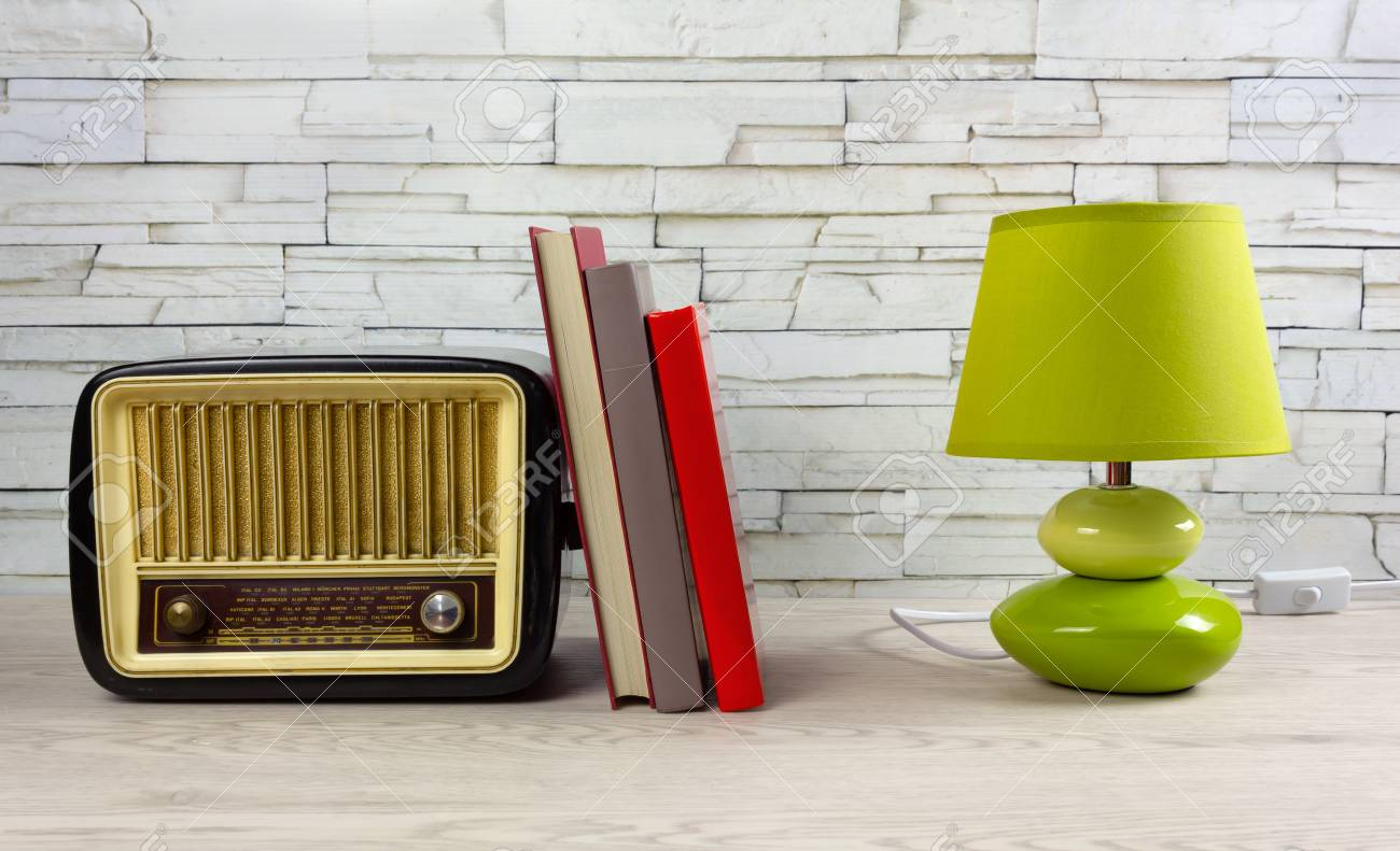 White Wooden Desk With A Few Books A Modern Table Lamp And A Stock Photo Picture And Royalty Free Image Image 123097364