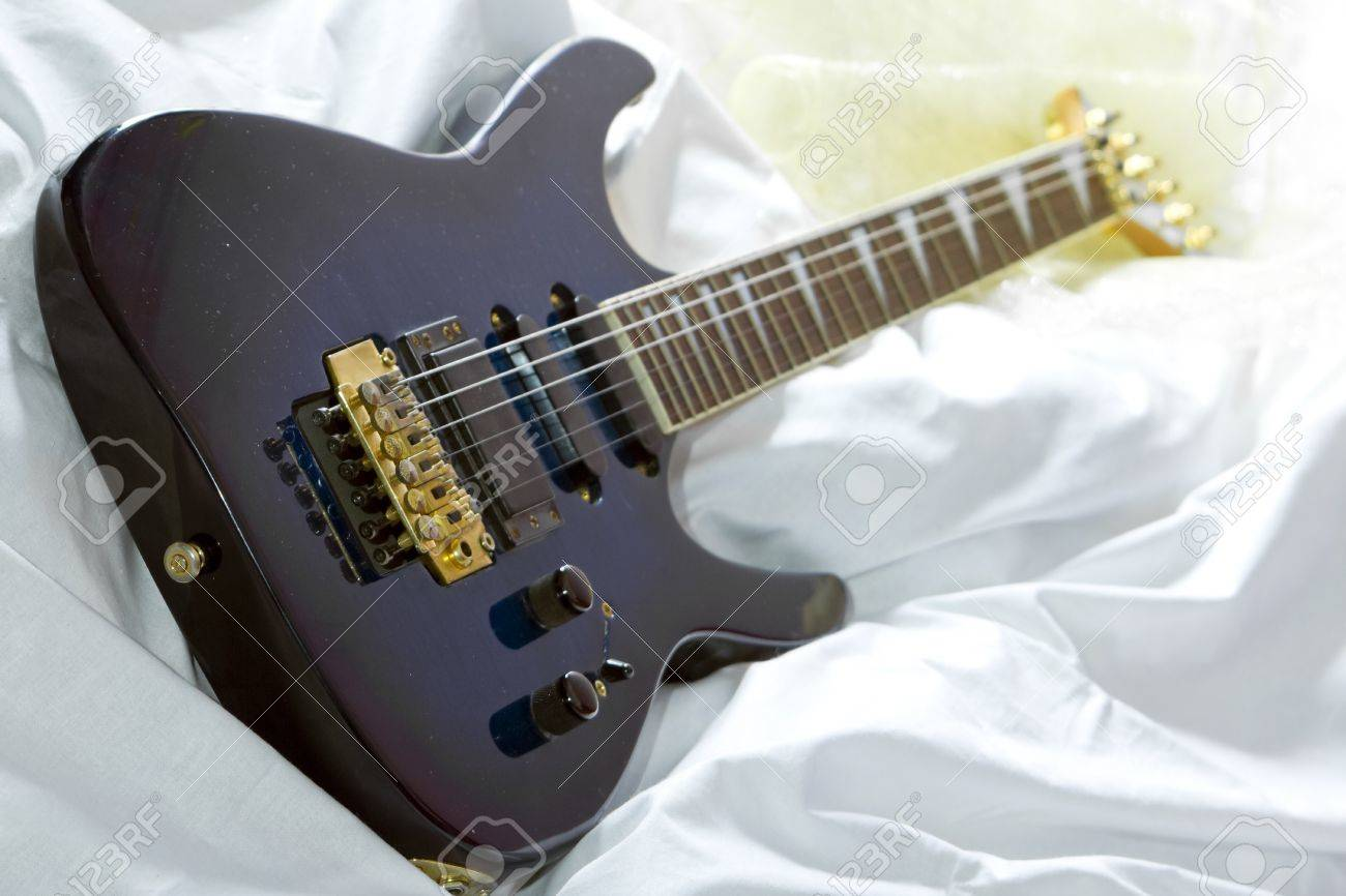 Blue Metal Guitar In The Bed Selective Focus Stock Photo Picture