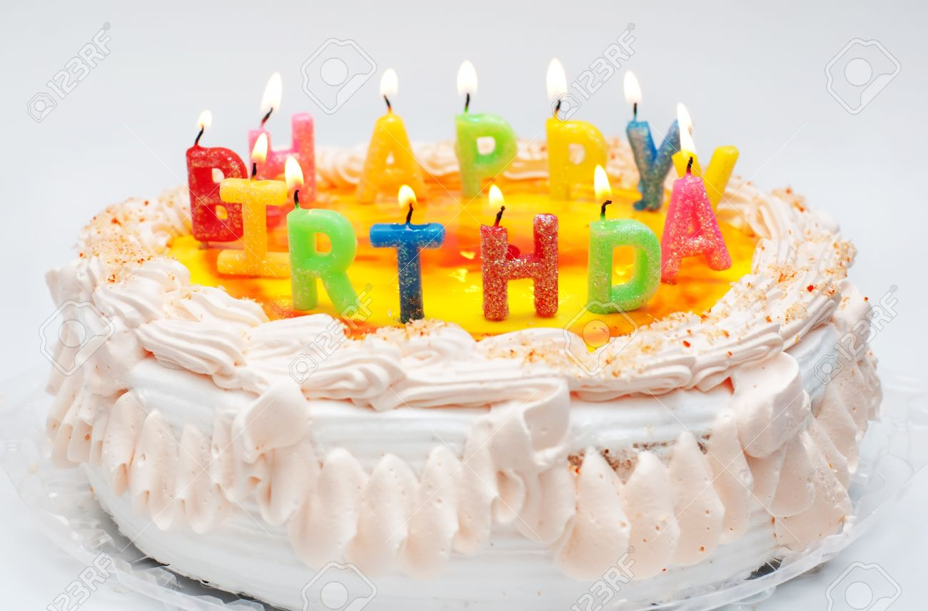 appetizing birthday cake with the light colorful candles with text happy birthday stock photo 18259524