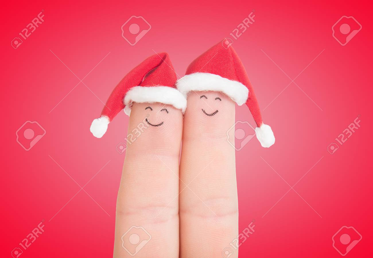 Fingers Faces In Santa Hats Isolated On White Background. Happy ...