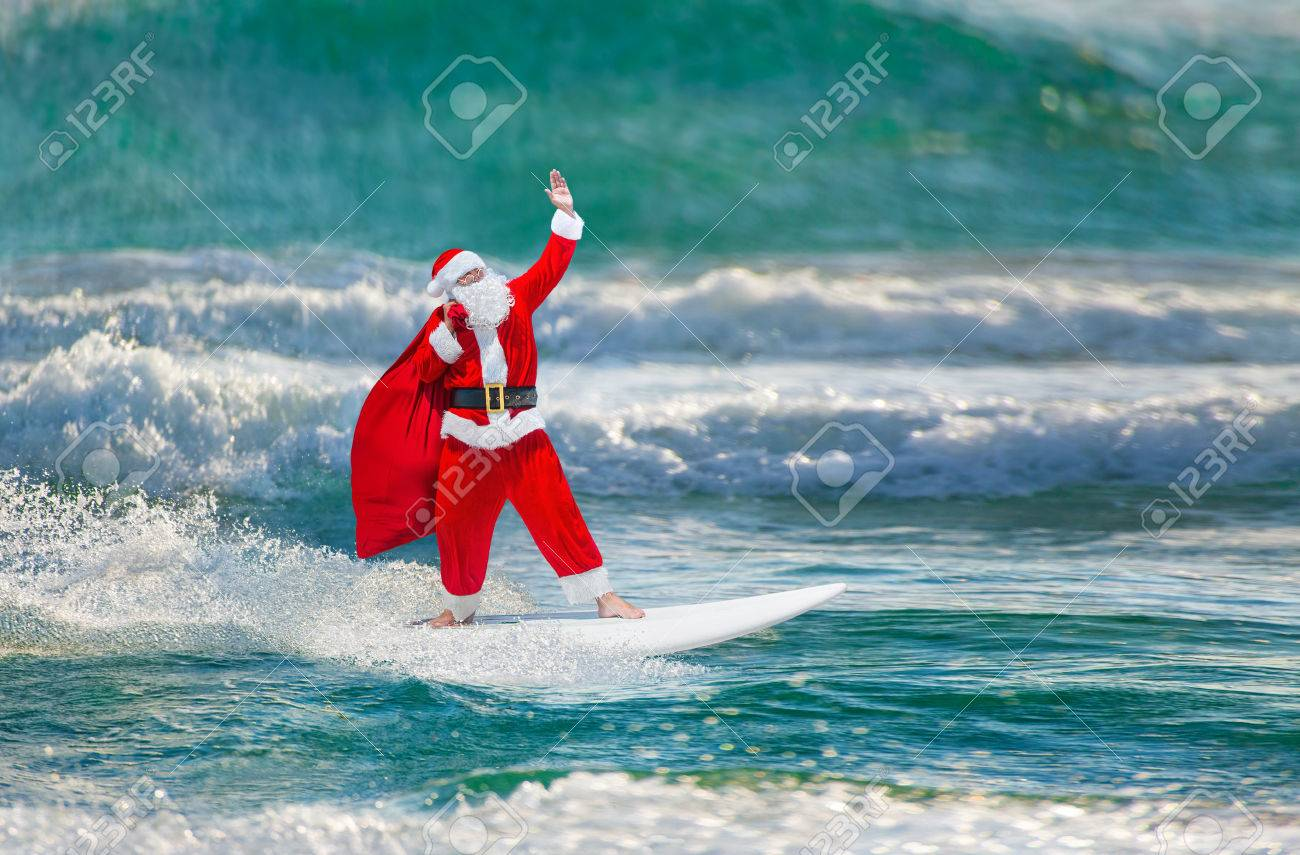 66275349-santa-claus-windsurfer-with-large-holiday-gifts-sack-go-surfing-with-surfboard-at-ocean-waves-splash.jpg