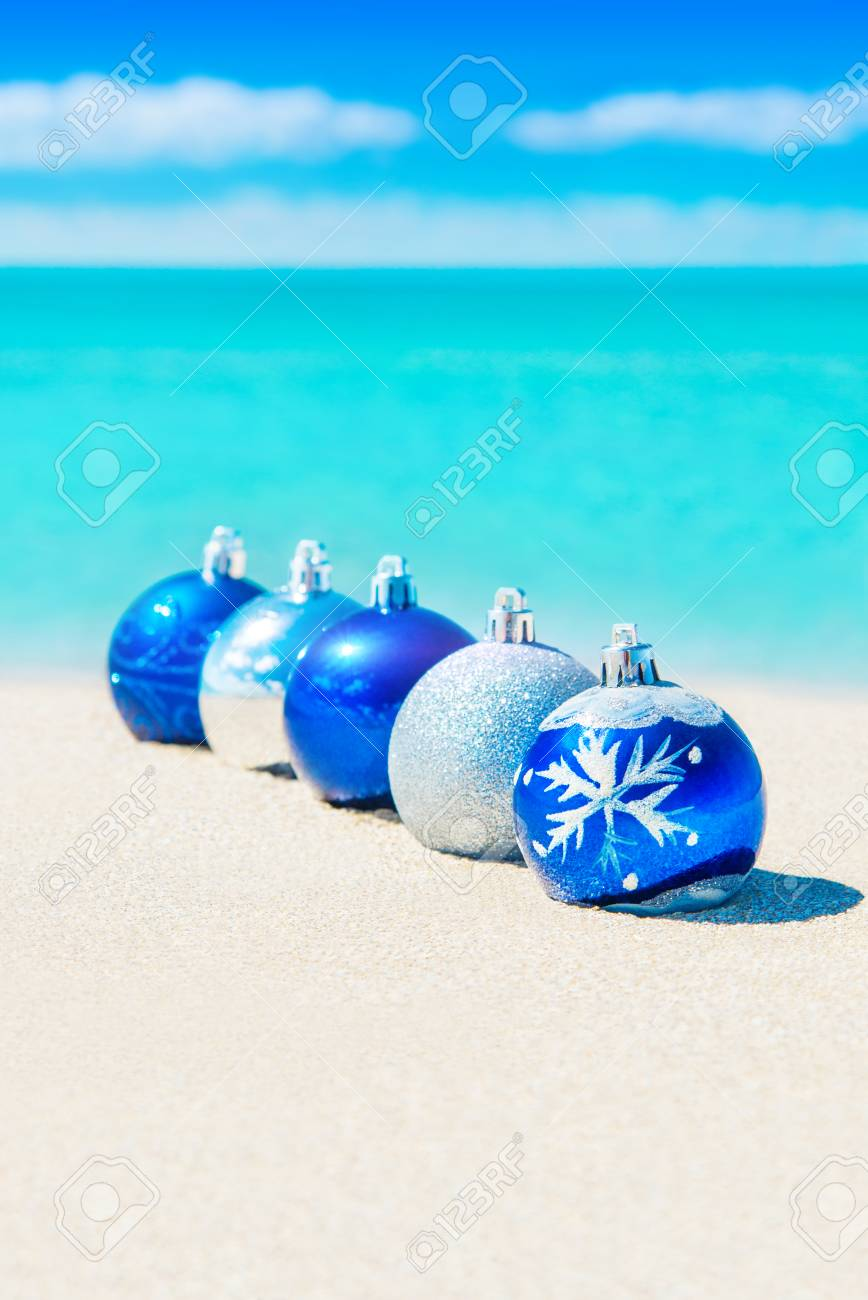 christmas tree balls decorations on sand of tropical ocean beach happy new year and merry
