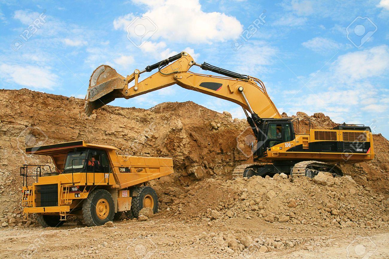 Backhoe loader loading dumper stock photo 4970492