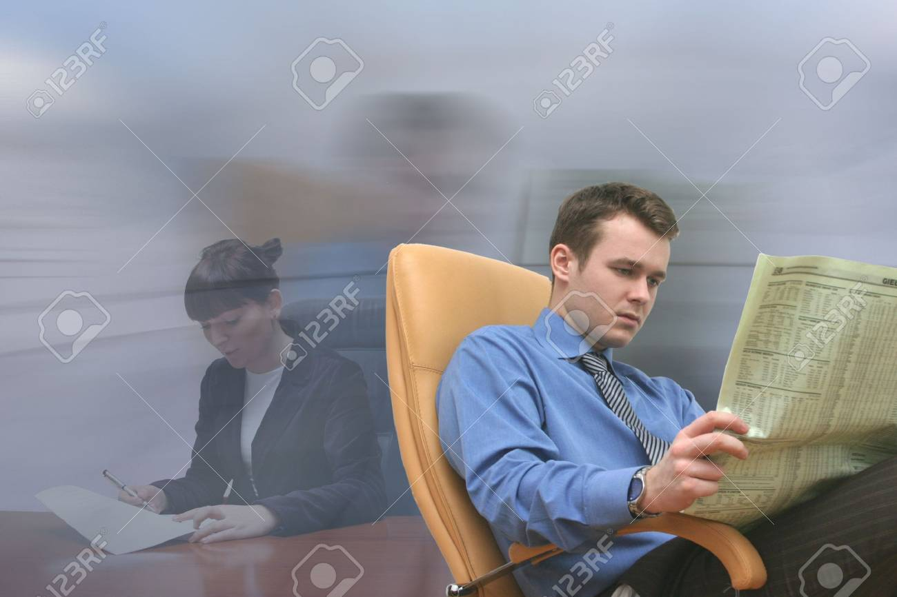 Young people browsing papers in the office Stock Photo - 433697