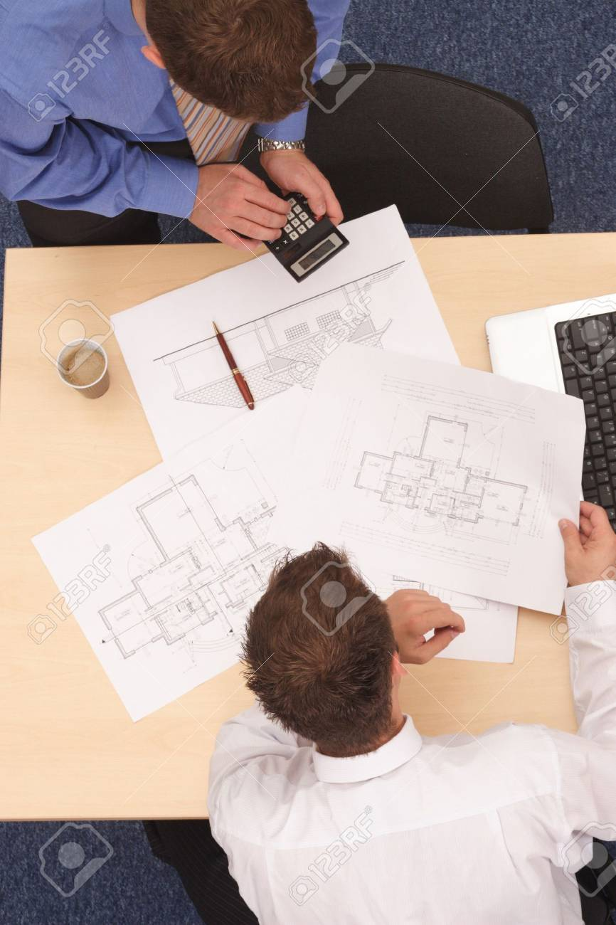 Aerial view of two businessmen calculating the plans. Stock Photo - 2137740