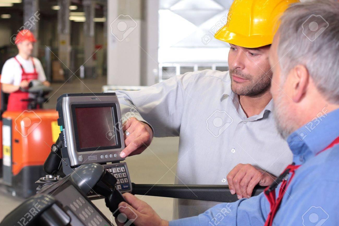 Supervisor Talking To Engineer Operator In Warehouse Stock Photo ...