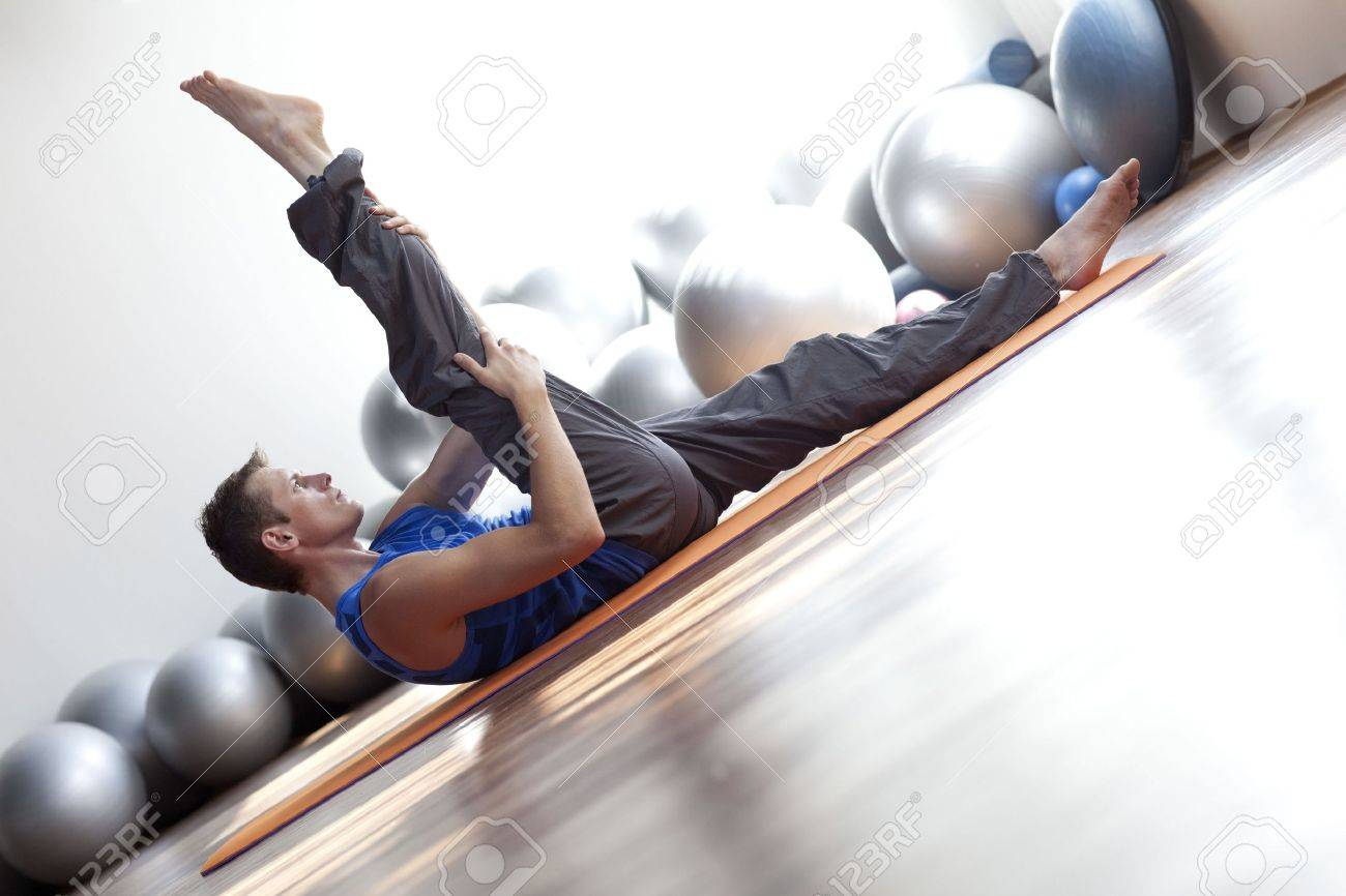 fusion of mind and body - man practicing pilates Stock Photo - 7856087