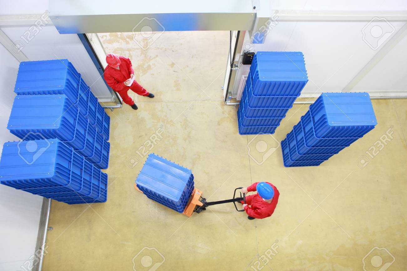 two workers preparing goods delivery in a small company warehouse - overhead view Stock Photo - 12978975