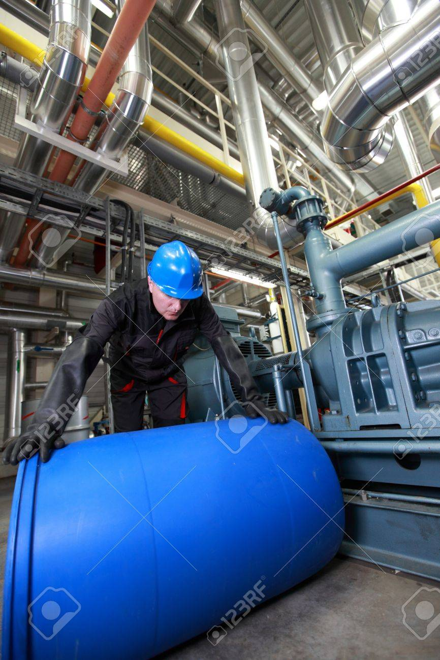 Worker in plant dealing with plastic barrel Stock Photo - 14744823